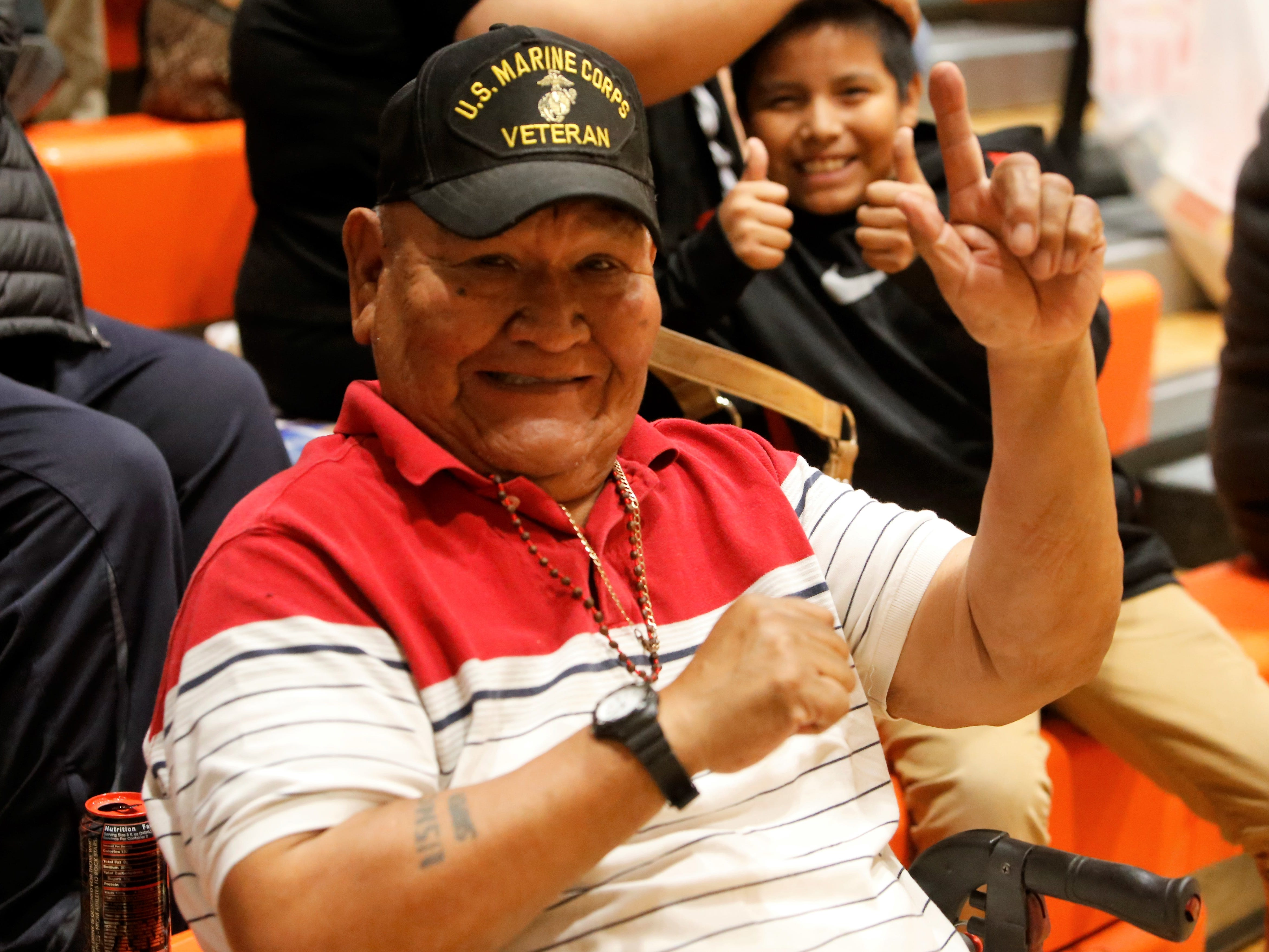 Former United States Marine Corps. Sergeant Robert Smart of Shiprock is all smiles during Friday's District 1-4A game between Aztec and Kirtland Central at Lillywhite Gym in Aztec.