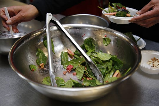 Spinach salad with berries, apples and nuts was among the dishes prepared during an Indigenous foods cooking demonstration on Friday at Navajo Technical University in Crownpoint.