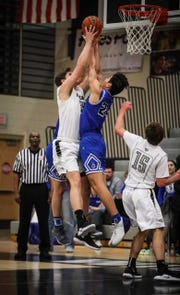 Plymouth's Ryan Berger (left) and Salem's Ben Dierker ascend for a rebound.