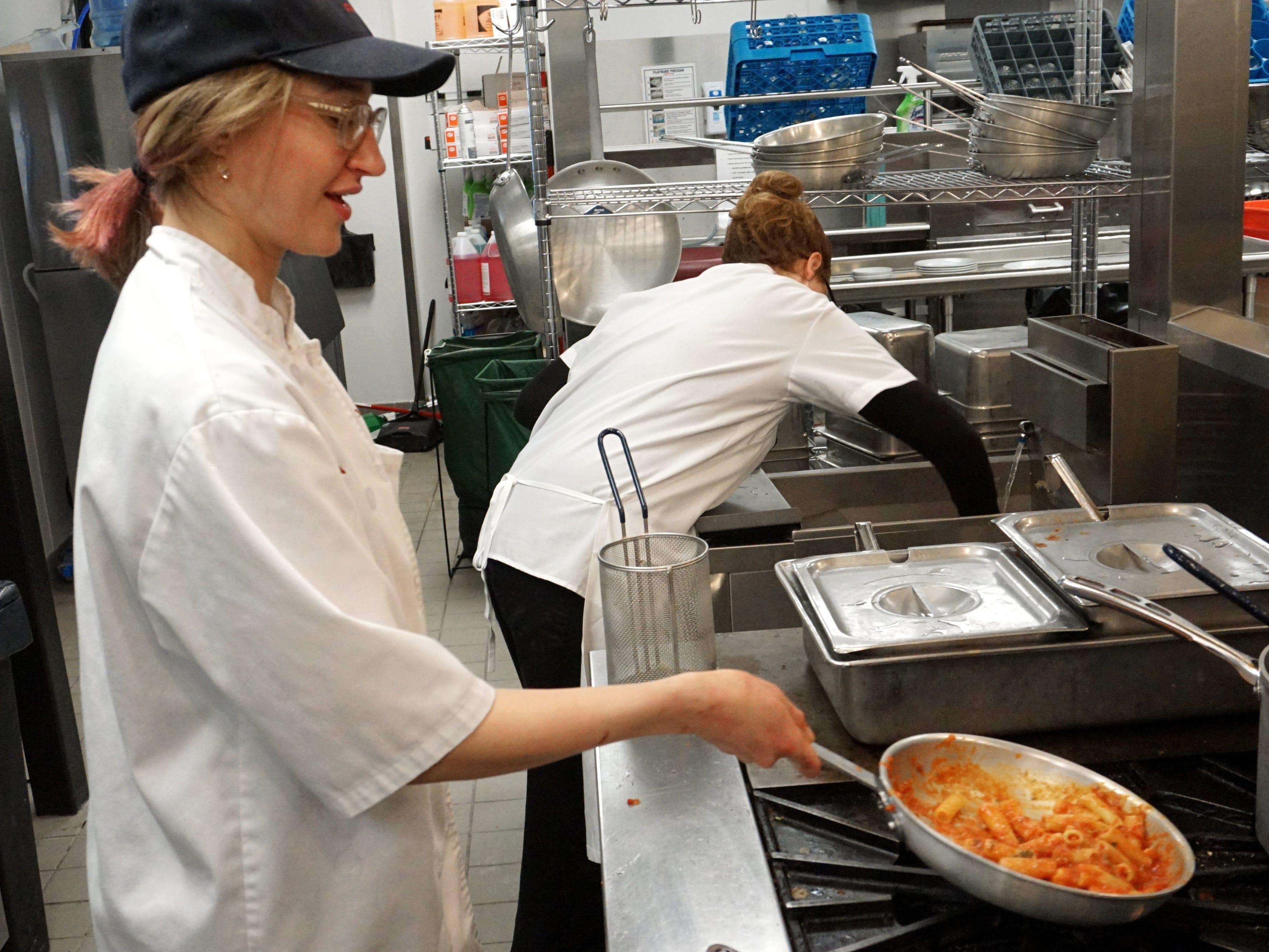 Bigalora chef Sydney Liepshutz works on some pasta that will go with a chicken parmesan dish.