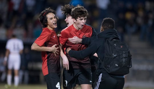 Despite being in pain from an injury, Danny Ramos (4) celebrates the victory with his teammates in the District 1-3A boys soccer tournament final between West Florida and Gulf Breeze at Gulf Breeze High School on Friday, February 1, 2019.  The Jaguars defeated the Dolphin 3-1.