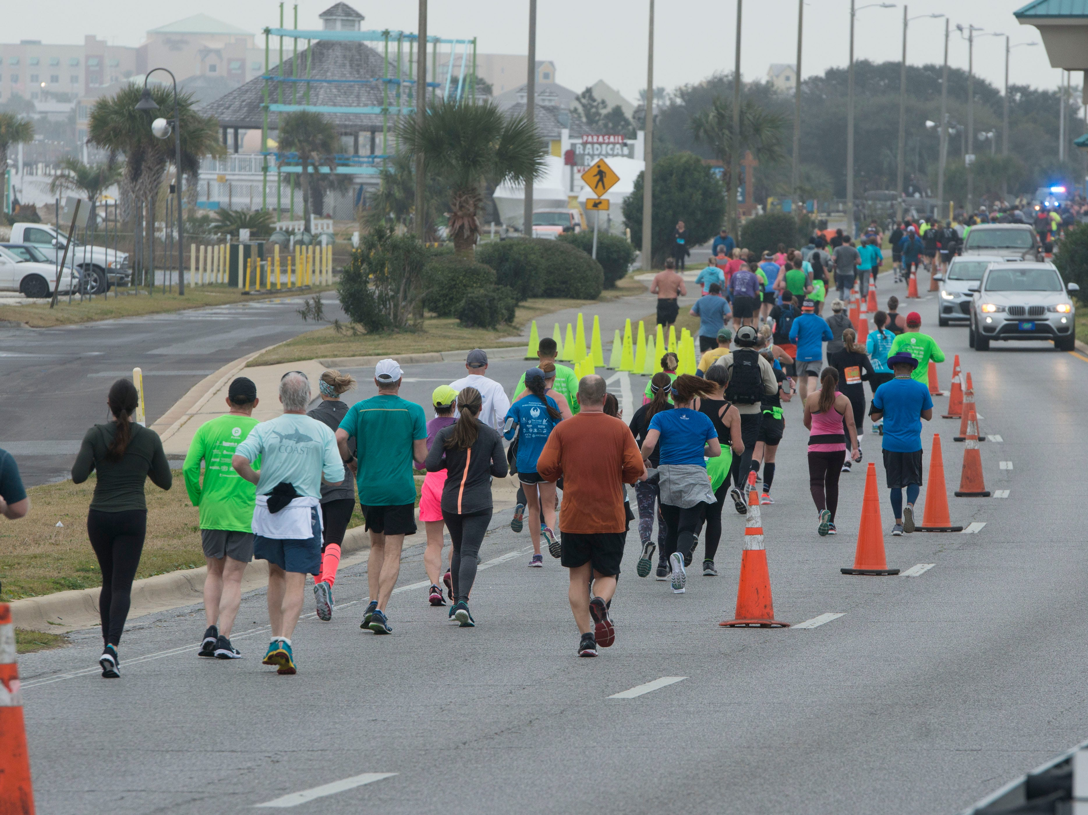 Runners make their way along the course Saturday, February 2, 2019 during the Pensacola Double Bridge Run presented by Publix. The 15K carries runners over two bridges, across Pensacola Bay and Santa Rosa Sound. It will run from downtown Pensacola with a tour that includes the historic district, and picturesque Bayfront Parkway, a run through Gulf Breeze, and onto Pensacola Beach. The 5K invites both runners and walkers to travel from Gulf Breeze to beautiful Pensacola Beach on Santa Rosa Island and the Gulf Islands Seashore.