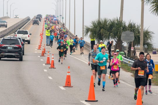 Runners make their way along the course during the 2019 Pensacola Double Bridge Run presented by Publix.