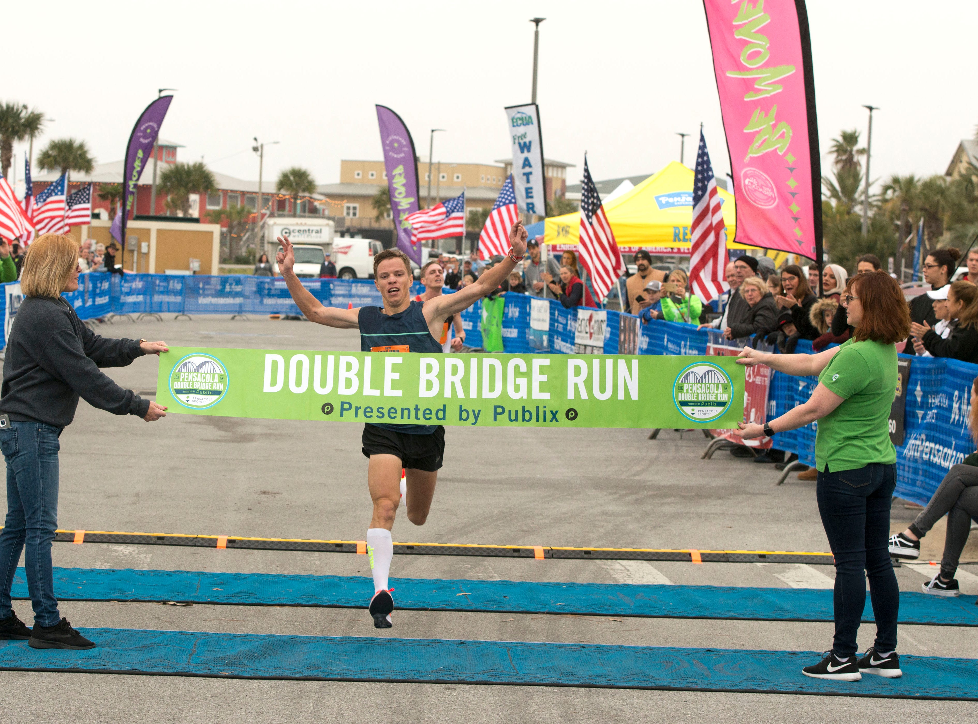 Sergey Zyryanov crosses the finish line as the first finisher of the 15k Saturday, February 2, 2019 during the Pensacola Double Bridge Run presented by Publix. The 15K carries runners over two bridges, across Pensacola Bay and Santa Rosa Sound. It will run from downtown Pensacola with a tour that includes the historic district, and picturesque Bayfront Parkway, a run through Gulf Breeze, and onto Pensacola Beach. The 5K invites both runners and walkers to travel from Gulf Breeze to beautiful Pensacola Beach on Santa Rosa Island and the Gulf Islands Seashore.