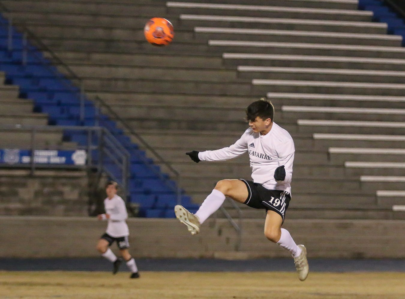 Navarre's Kobe Banks (19) knocks a header back into the Niceville zone during the District 1-4A championship game at Washington High School on Friday, February 1, 2019. For the second straight year, Niceville shut-out Navarre to win the championship. Last year, the score was 6-0 and this year it was 7-0.