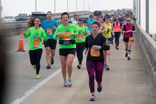 Runners make their way along the course during a previous Pensacola Double Bridge Run. This year's run gets going on Saturday.