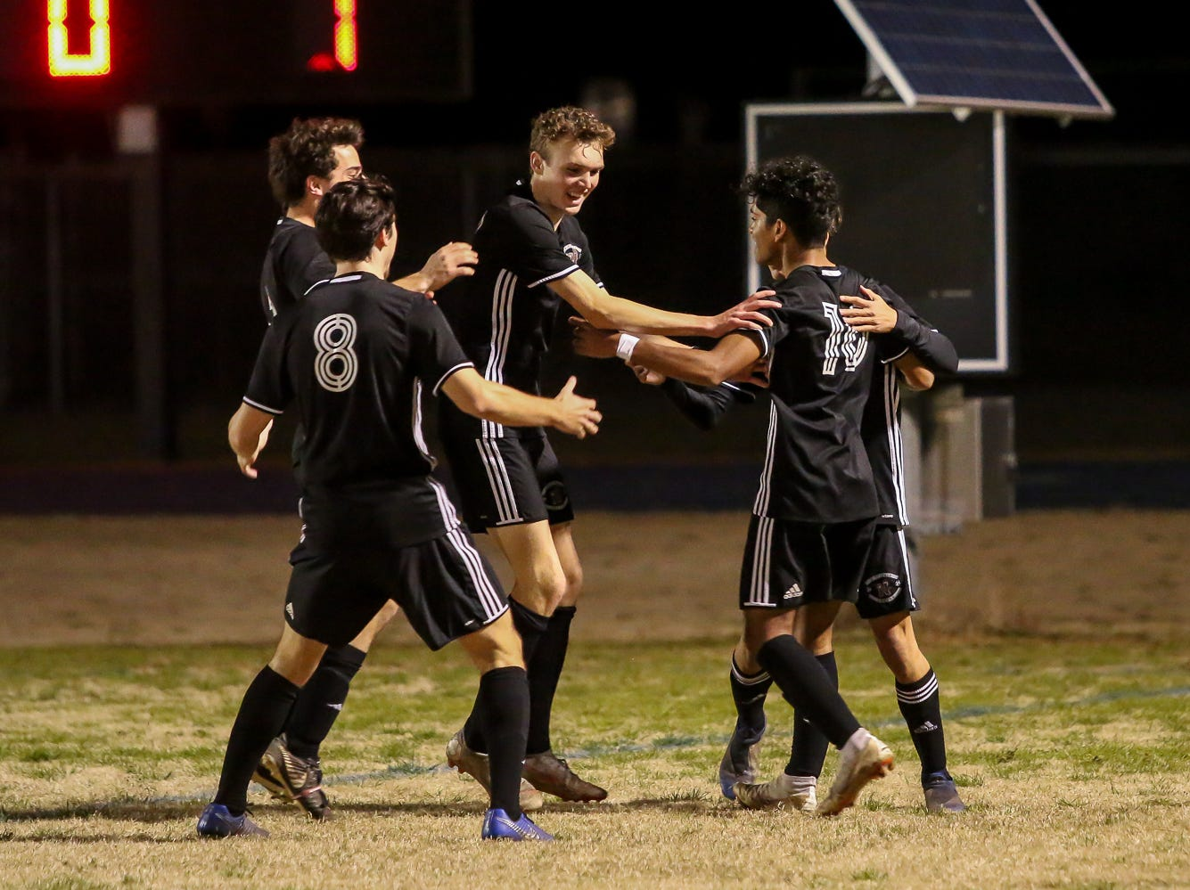 After scoring a goal against Navarre, Niceville's Liam Etan (10) is congratulated by his teammates in the District 1-4A championship game at Washington High School on Friday, February 1, 2019. For the second straight year, Niceville shut-out Navarre to win the championship. Last year, the score was 6-0 and this year it was 7-0.