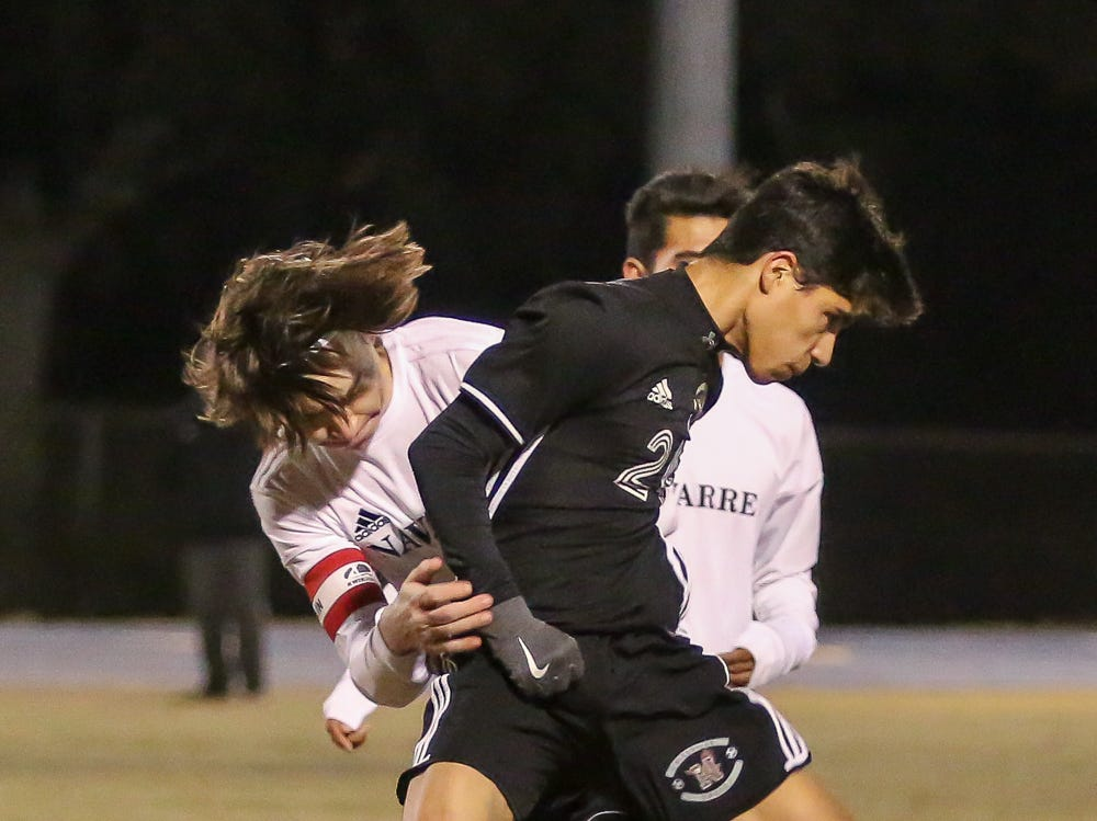 Niceville's James Hawver (24) and Navarre's Colby Burton (3) run into each other after Burton cleared the ball in the District 1-4A championship game at Washington High School on Friday, February 1, 2019. For the second straight year, Niceville shut-out Navarre to win the championship. Last year, the score was 6-0 and this year it was 7-0.