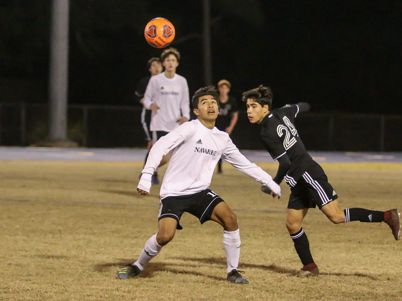 Navarre's Joel Recinos (10) and Niceville's James Hawver (24) chase after the ball in the District 1-4A championship game at Washington High School on Friday, February 1, 2019. For the second straight year, Niceville shut-out Navarre to win the championship. Last year, the score was 6-0 and this year it was 7-0.