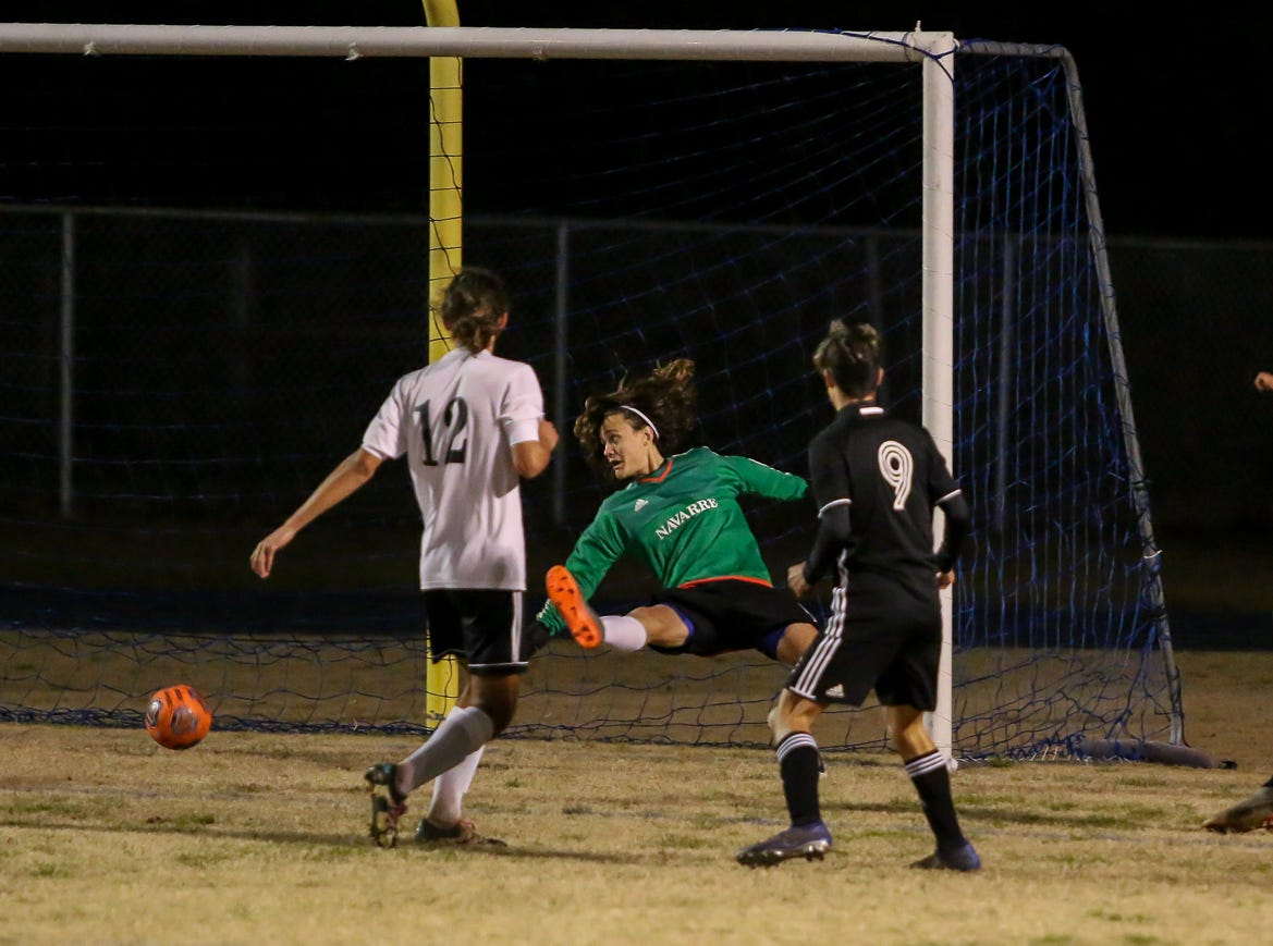 Navarre goalkeeper Kalvin Coppock (16) can't stop the shot by Niceville's Liam Etan (10) from going into the net in the District 1-4A championship game at Washington High School on Friday, February 1, 2019. For the second straight year, Niceville shut-out Navarre to win the championship. Last year, the score was 6-0 and this year it was 7-0.