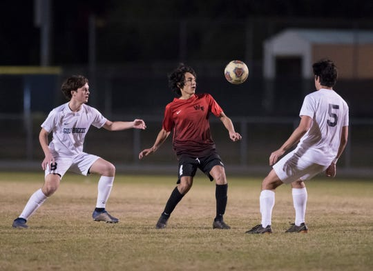 (4) takes control of the ball during the District 1-3A boys soccer tournament final between West Florida and Gulf Breeze at Gulf Breeze High School on Friday, February 1, 2019.  The Jaguars defeated the Dolphin 3-1.