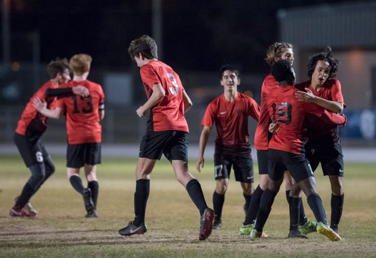 The Jaguars celebrate taking a 2-0 lead during the District 1-3A boys soccer tournament final between West Florida and Gulf Breeze at Gulf Breeze High School on Friday, February 1, 2019.  The Jaguars defeated the Dolphin 3-1.
