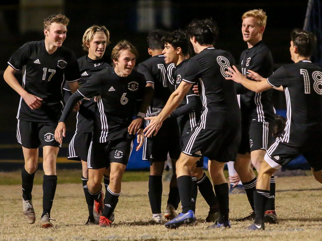 Niceville's Jacob Simmons (6) is congratulated by his teammates after scoring a goal against Navarre in the District 1-4A championship game at Washington High School on Friday, February 1, 2019. For the second straight year, Niceville shut-out Navarre to win the championship. Last year, the score was 6-0 and this year it was 7-0.