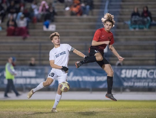 Colby Copeland (19) and Noah Trahan (19) play the ball during the District 1-3A boys soccer tournament final between West Florida and Gulf Breeze at Gulf Breeze High School on Friday, February 1, 2019.