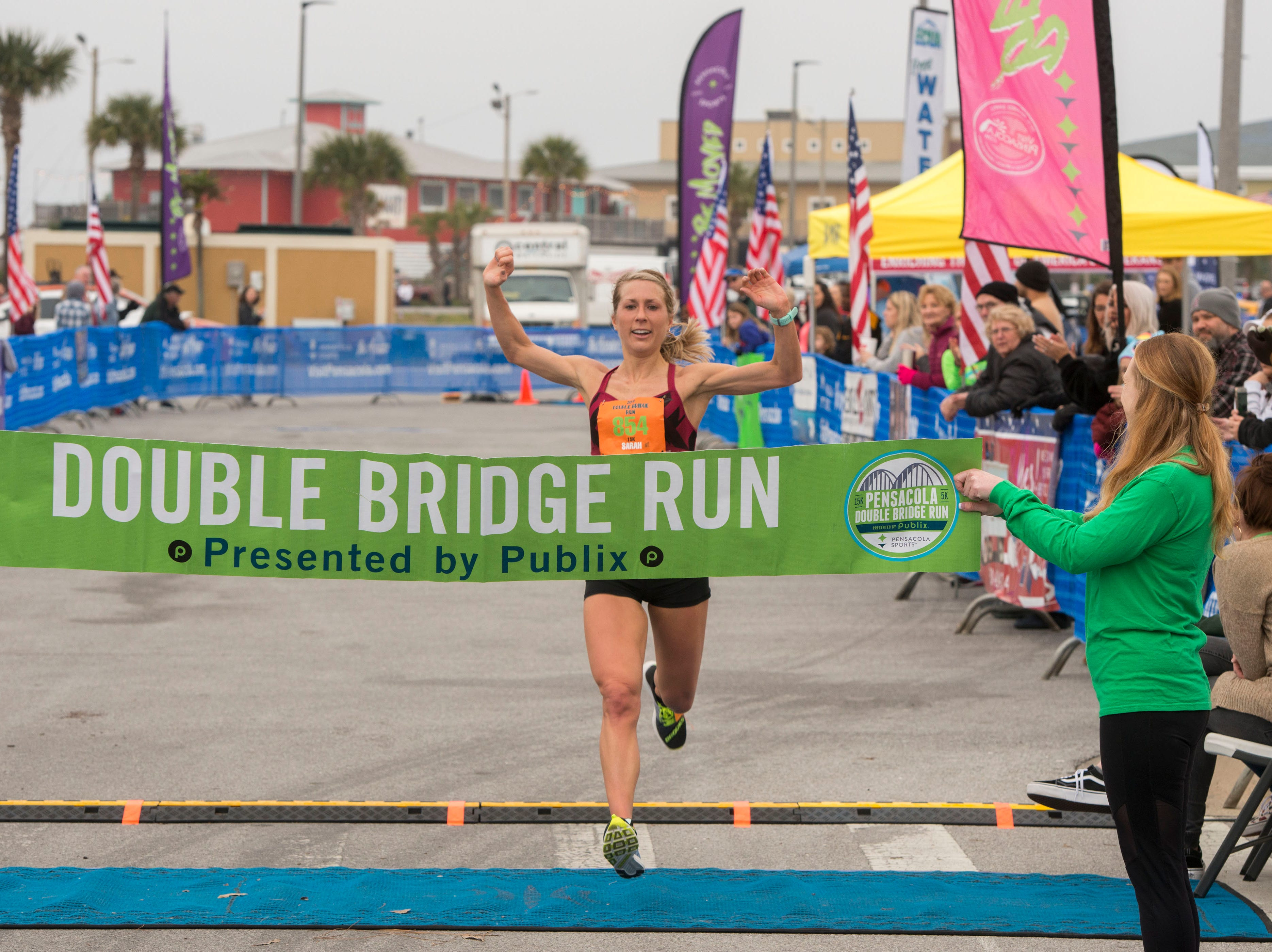 Sarah Harbol corsses the finish line as the first female finisher of the 15 k Saturday, February 2, 2019 during the Pensacola Double Bridge Run presented by Publix. The 15K carries runners over two bridges, across Pensacola Bay and Santa Rosa Sound. It will run from downtown Pensacola with a tour that includes the historic district, and picturesque Bayfront Parkway, a run through Gulf Breeze, and onto Pensacola Beach. The 5K invites both runners and walkers to travel from Gulf Breeze to beautiful Pensacola Beach on Santa Rosa Island and the Gulf Islands Seashore.