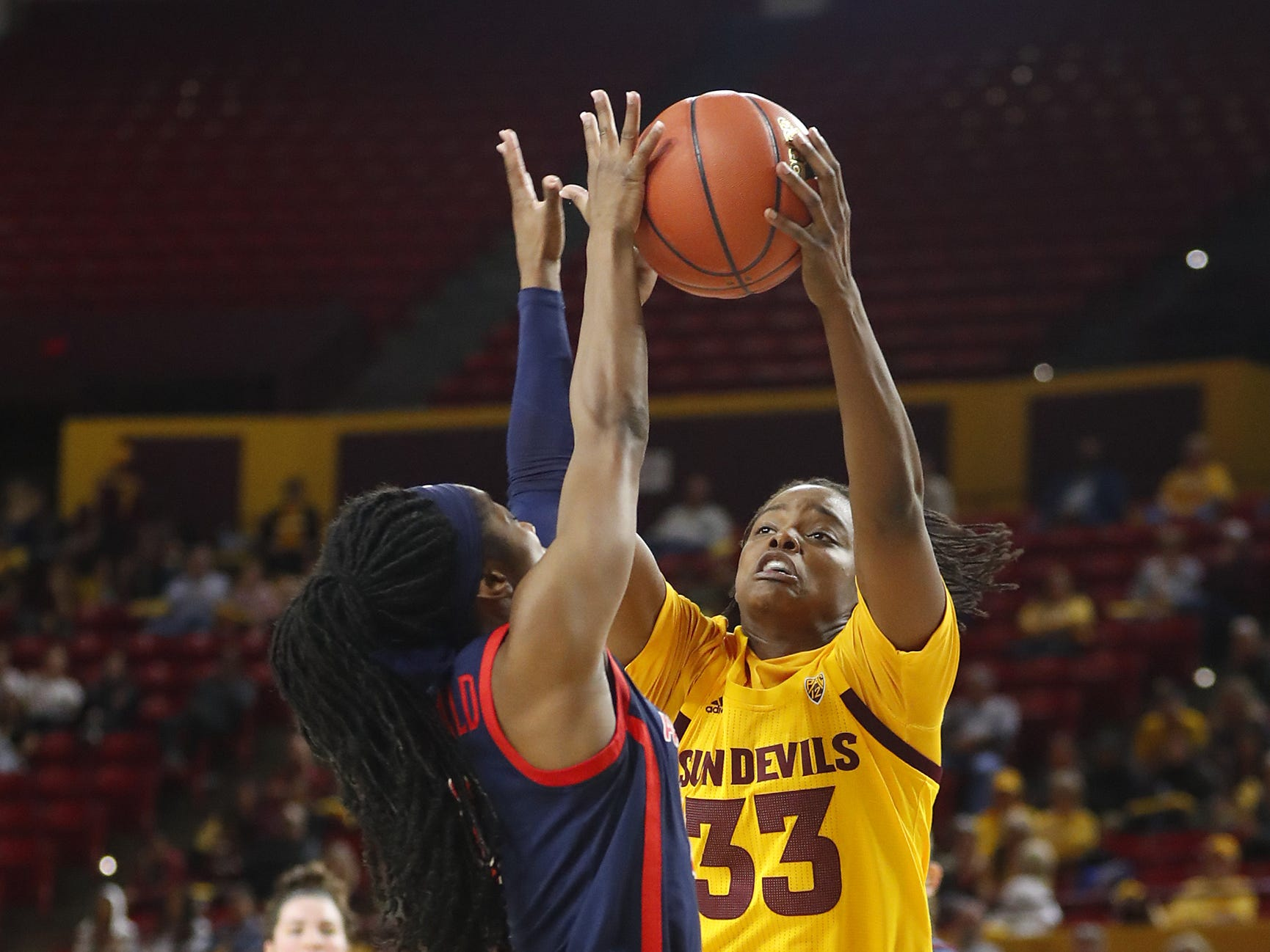 ASU's Charnea Johnson-Chapman (33) shoots against Arizona's Aari McDonald (2) during the second half at Wells Fargo Arena in Tempe, Ariz. on February 1, 2019.