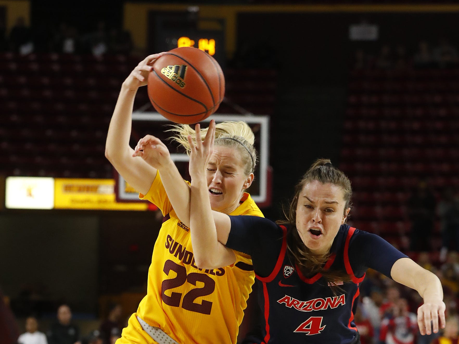 ASU's Courtney Ekmark (22) drives the lane against Arizona's Lucia Alonso (4) during the first half at Wells Fargo Arena in Tempe, Ariz. on February 1, 2019.