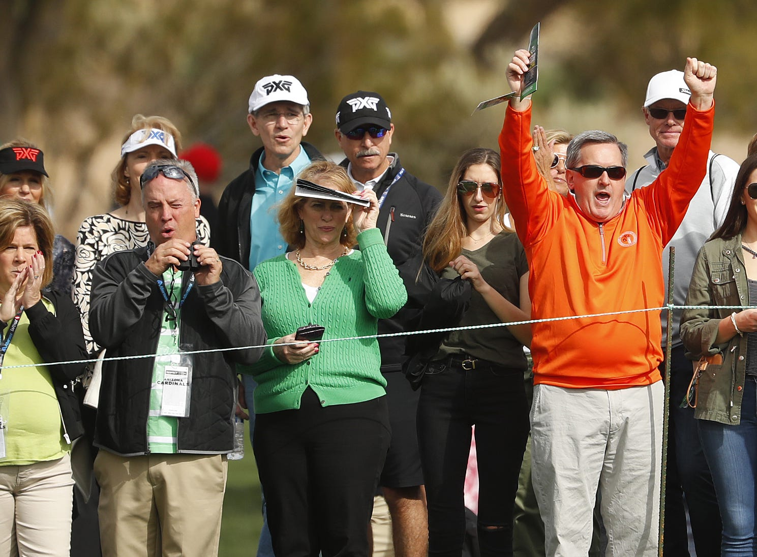 Fans react to a made putt on the 9th green during the third round of the Waste Management Phoenix Open at TPC Scottsdale in Scottsdale, Ariz. on February 2, 2019.