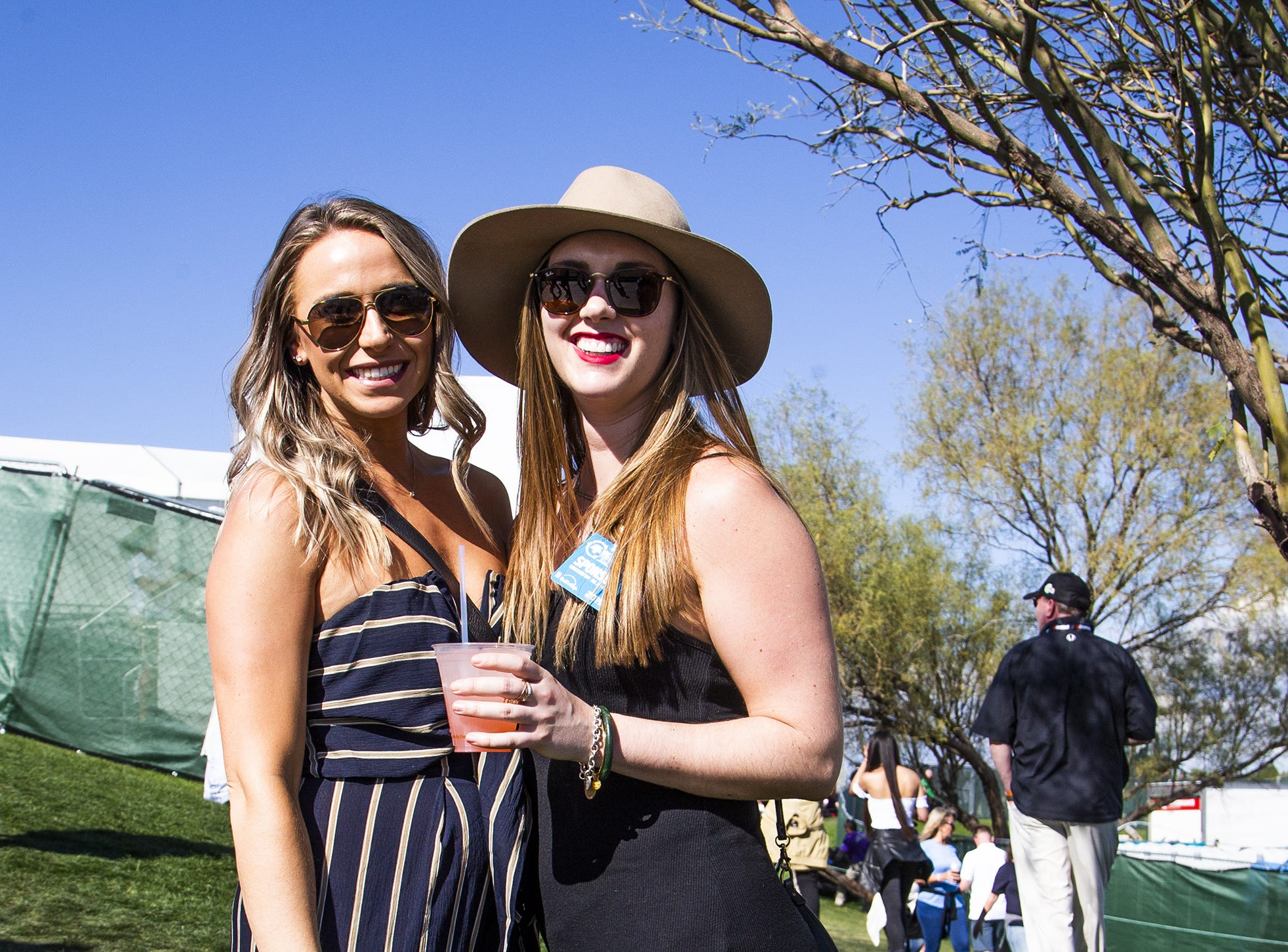 Kristi Pedersen, left, and Erin Vanderwall, both 26, dress to impress during the second round of the Waste Management Phoenix Open at the TPC Scottsdale, Friday, February 1, 2019.
