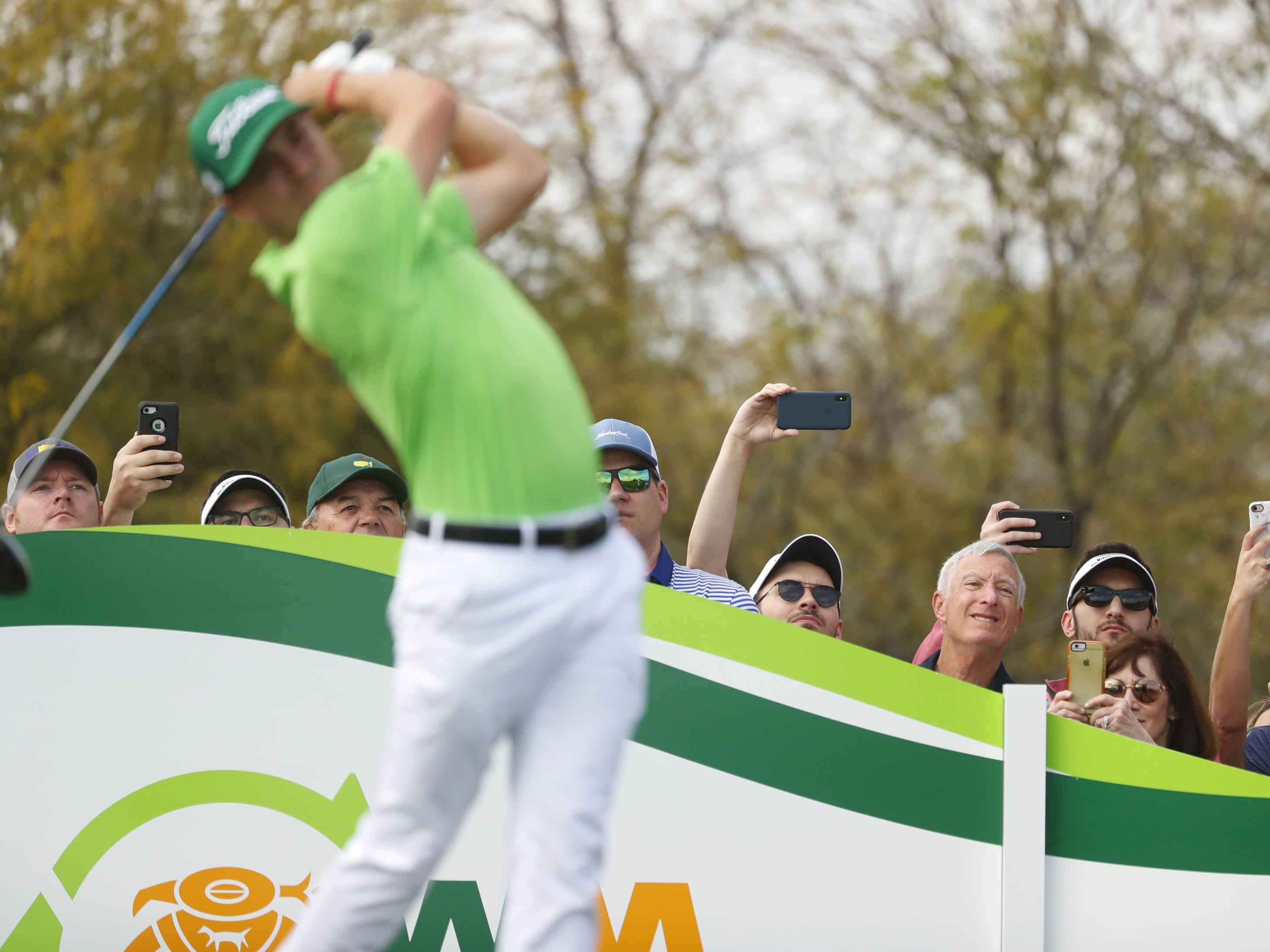 Fans watch Justin Thomas tee off during the third round of the Waste Management Phoenix Open at TPC Scottsdale in Scottsdale, Ariz. on February 2, 2019.