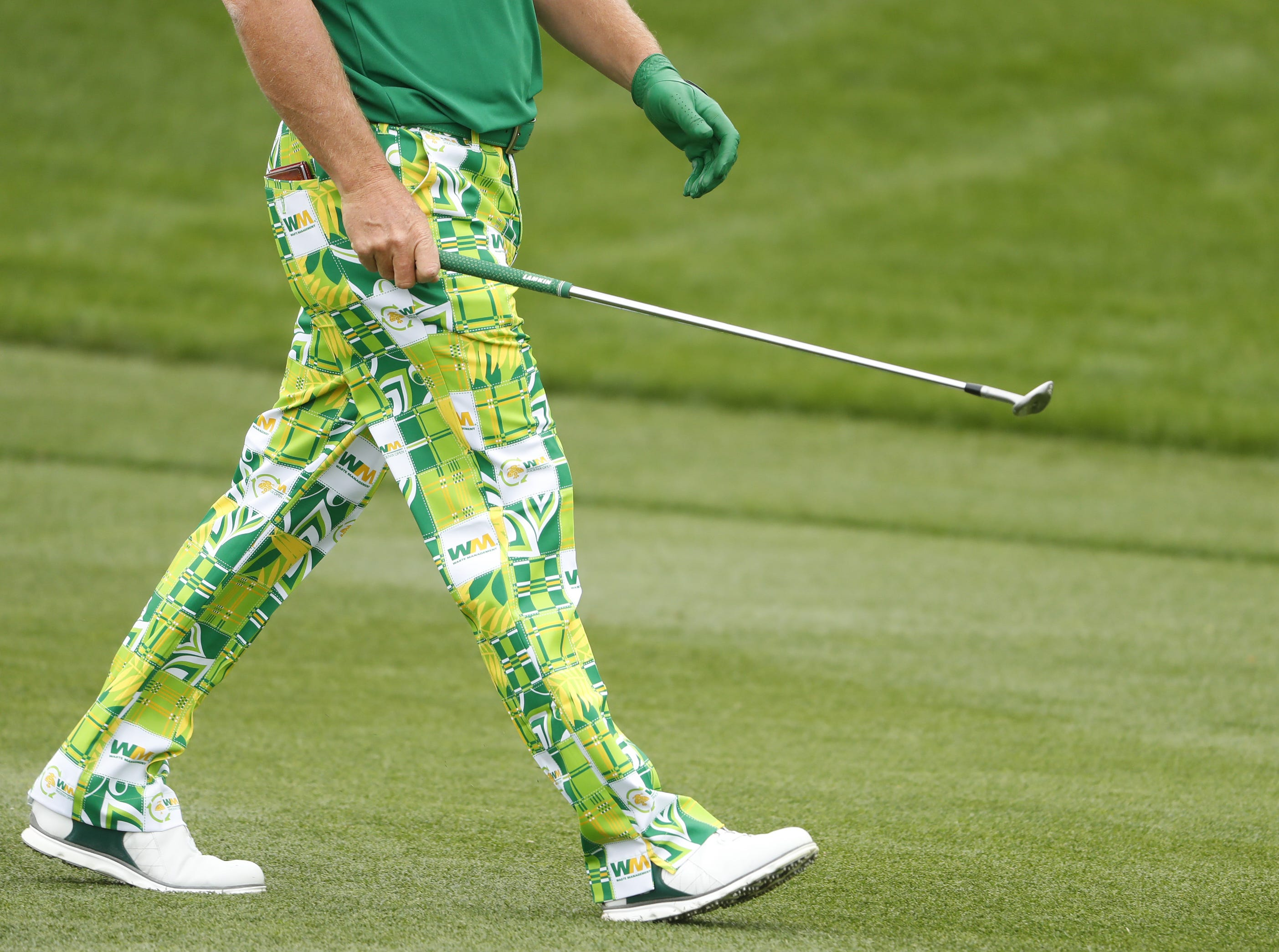 Charley Hoffman's green outfit as he walks to the 2nd green during the third round of the Waste Management Phoenix Open at TPC Scottsdale in Scottsdale, Ariz. on February 2, 2019.