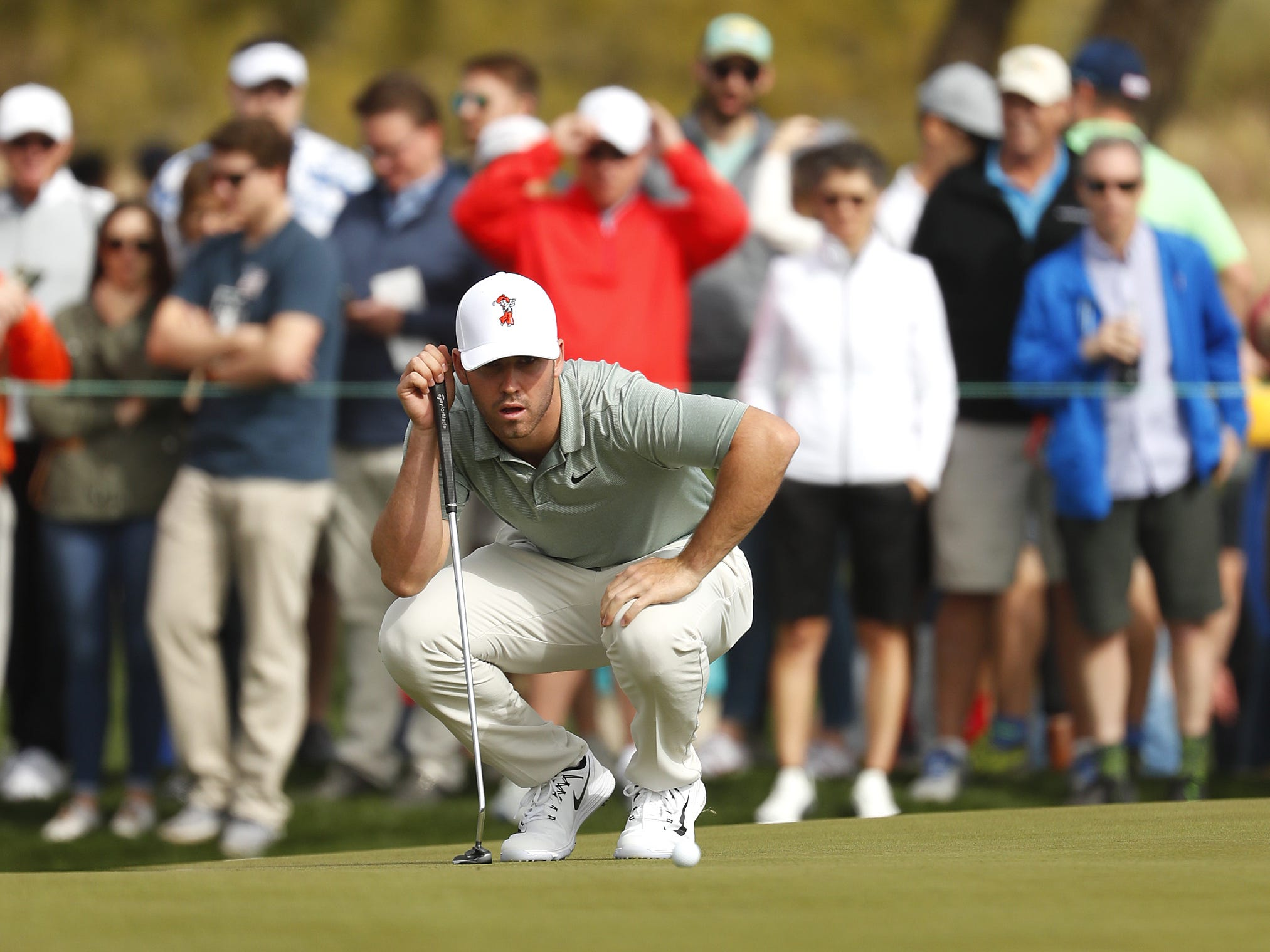 Matthew Wolff lines up a putt on the 9th green during the third round of the Waste Management Phoenix Open at TPC Scottsdale in Scottsdale, Ariz. on February 2, 2019.