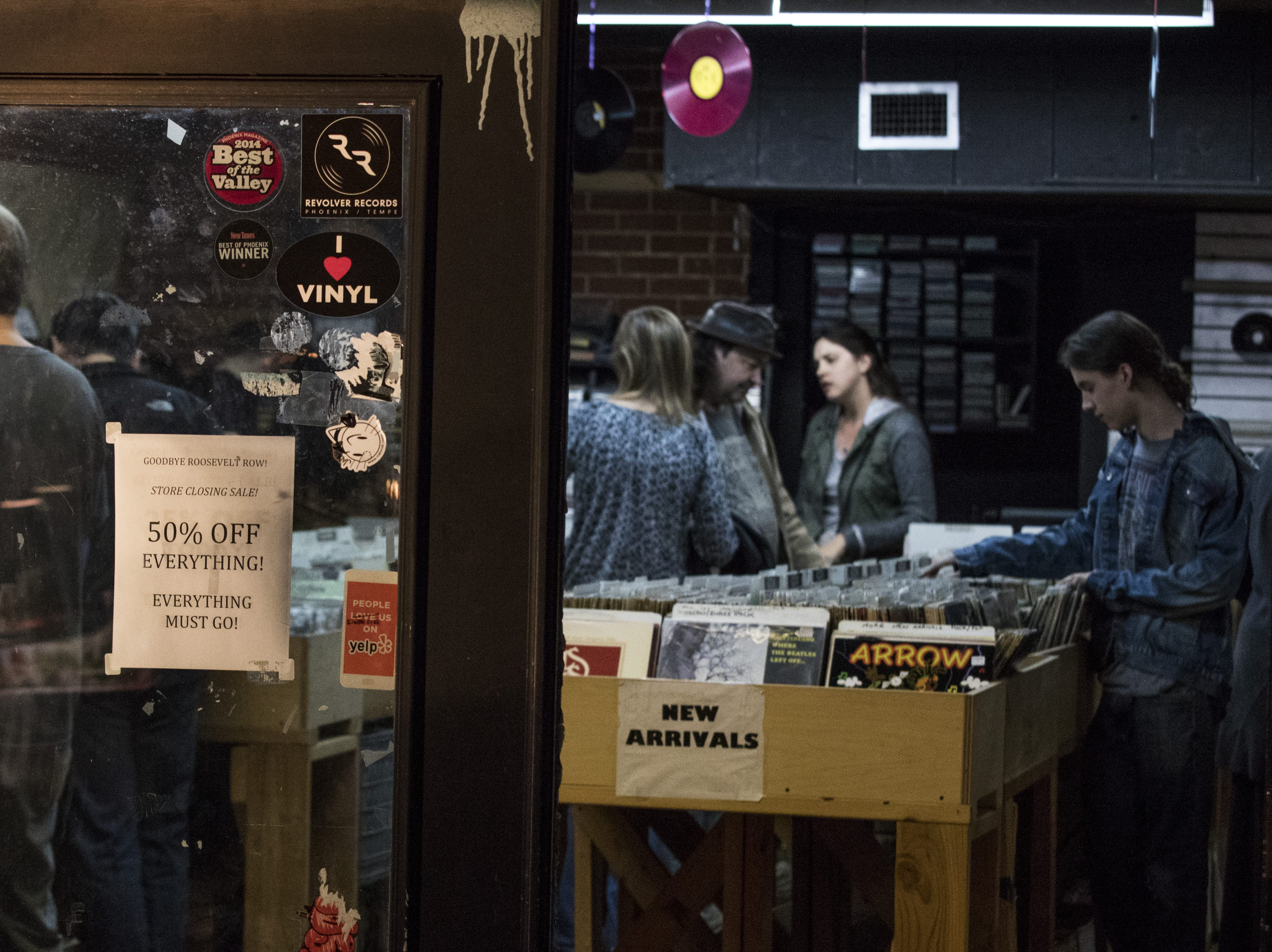 During First Friday, music lovers sort through albums at Revolver Records in downtown Phoenix.