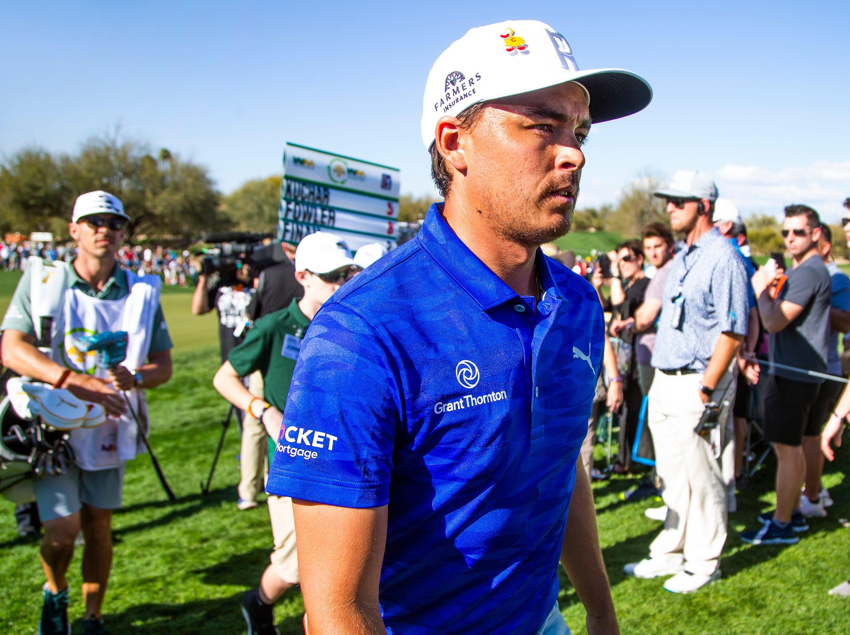 Rickie Fowler leaves the 9th hole during the second round of the Waste Management Phoenix Open at the TPC Scottsdale, Friday, February 1, 2019.
