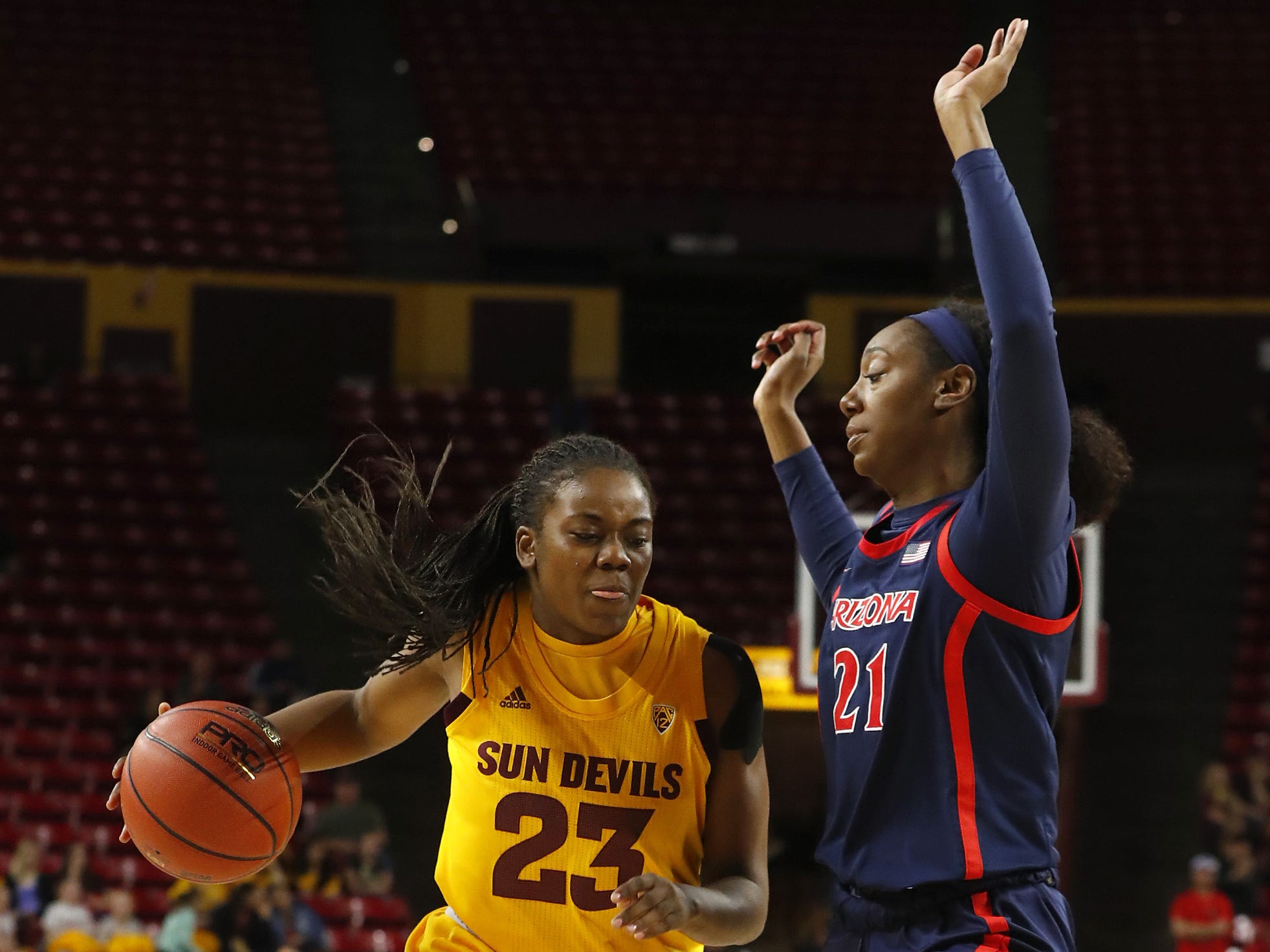 ASU's Iris Mbulito (23) drives the lane against Arizona's Destiny Graham (21) during the first half at Wells Fargo Arena in Tempe, Ariz. on February 1, 2019.