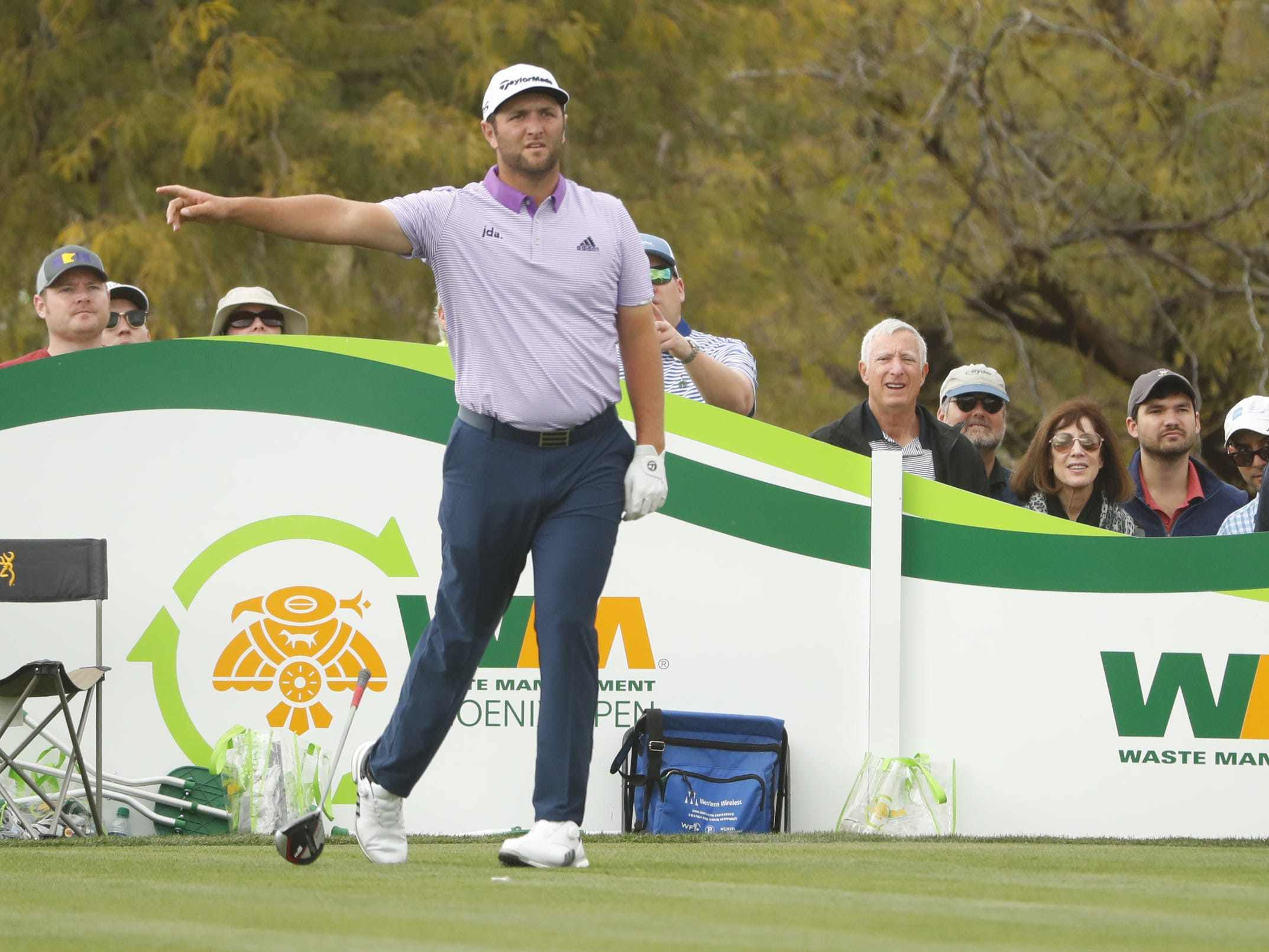 Jon Rahm points to his right after hitting from the tee box on the 8th hole during the third round of the Waste Management Phoenix Open at TPC Scottsdale in Scottsdale, Ariz. on February 2, 2019.