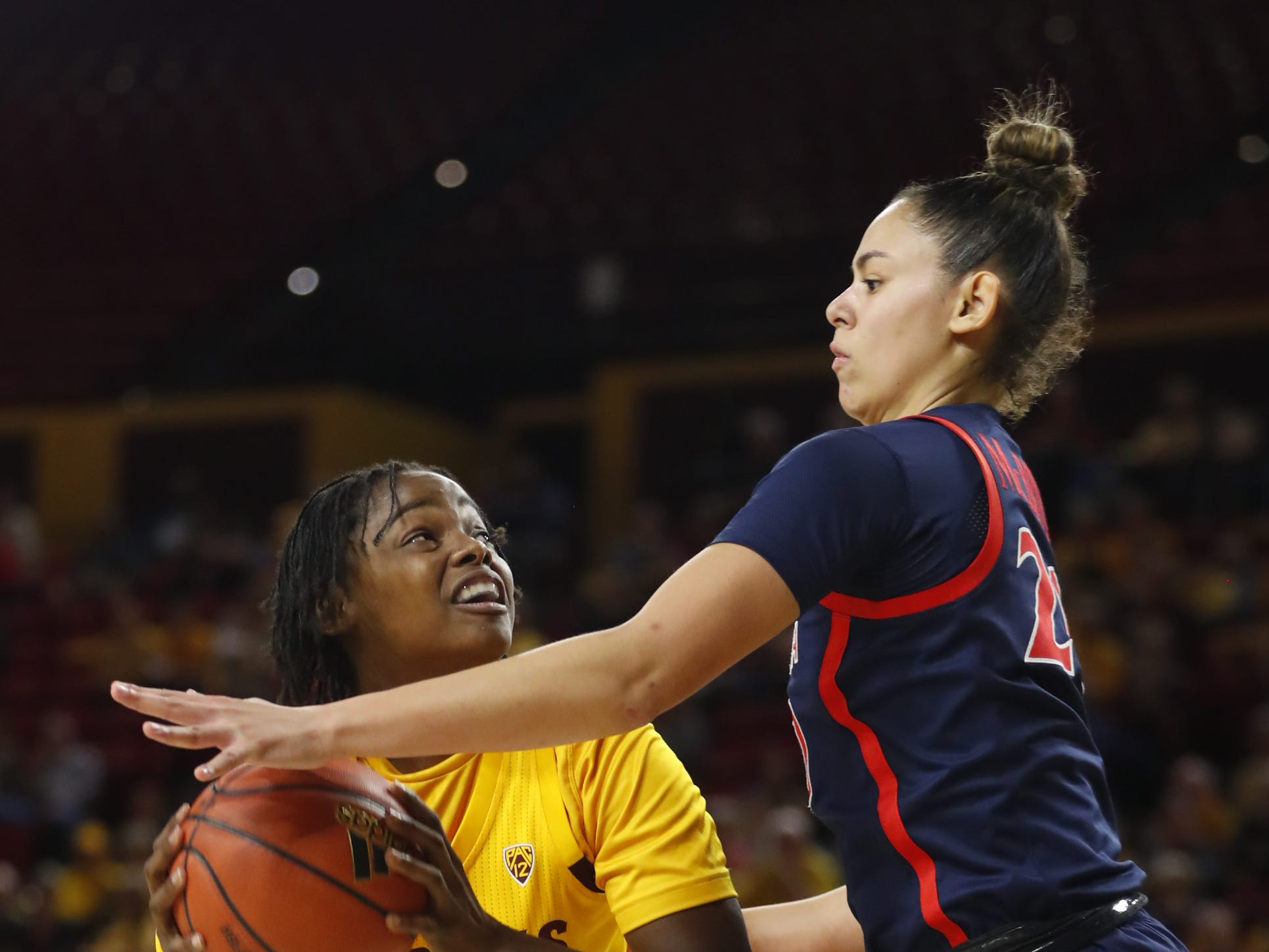 ASU's Charnea Johnson-Chapman (33) goes up for a basket against Arizona's Dominique McBryde (20) during the second half at Wells Fargo Arena in Tempe, Ariz. on February 1, 2019.