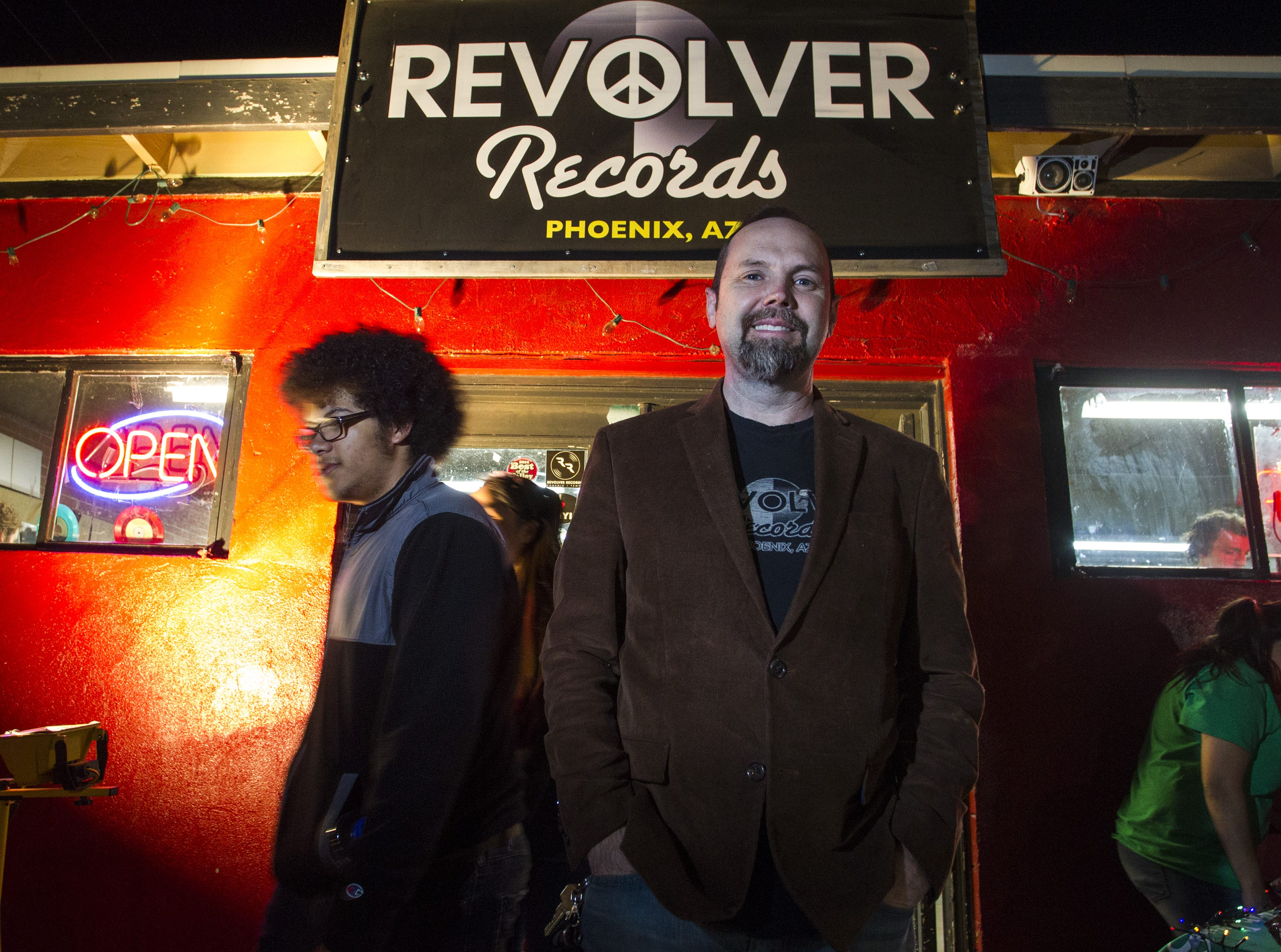 Revolver Records' owner TJ Jordan stands outside of his record store in downtown Phoenix on First Friday, Feb. 1, 2019. Jordan is closing Revolver Records on Feb. 10.