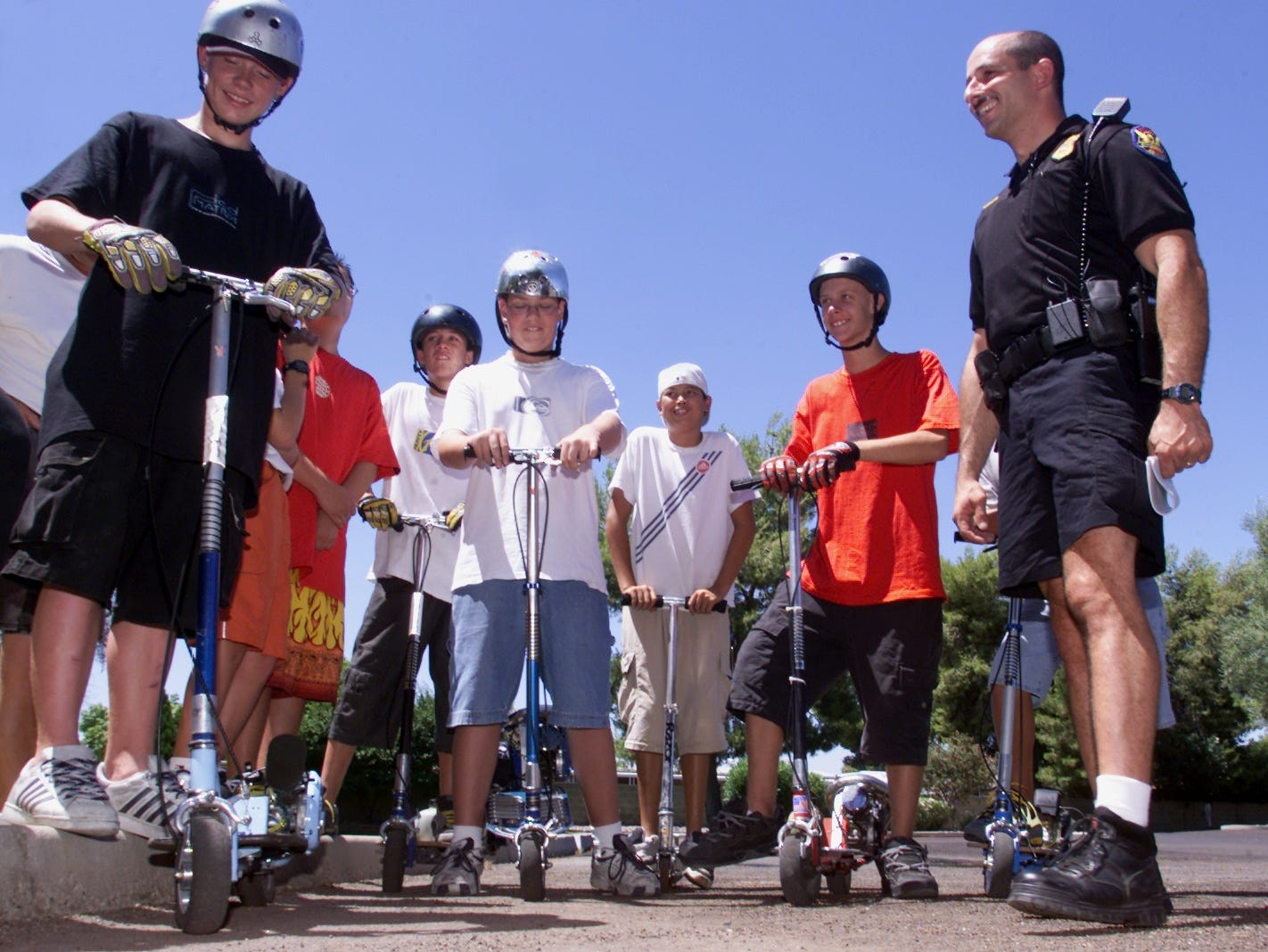 Riders of go-peds, or motorized skateboards, gather to hear Phoenix Police officer John Ferragamo give safety tips on how to use the motorized scooters safely in this 2001 file photo.