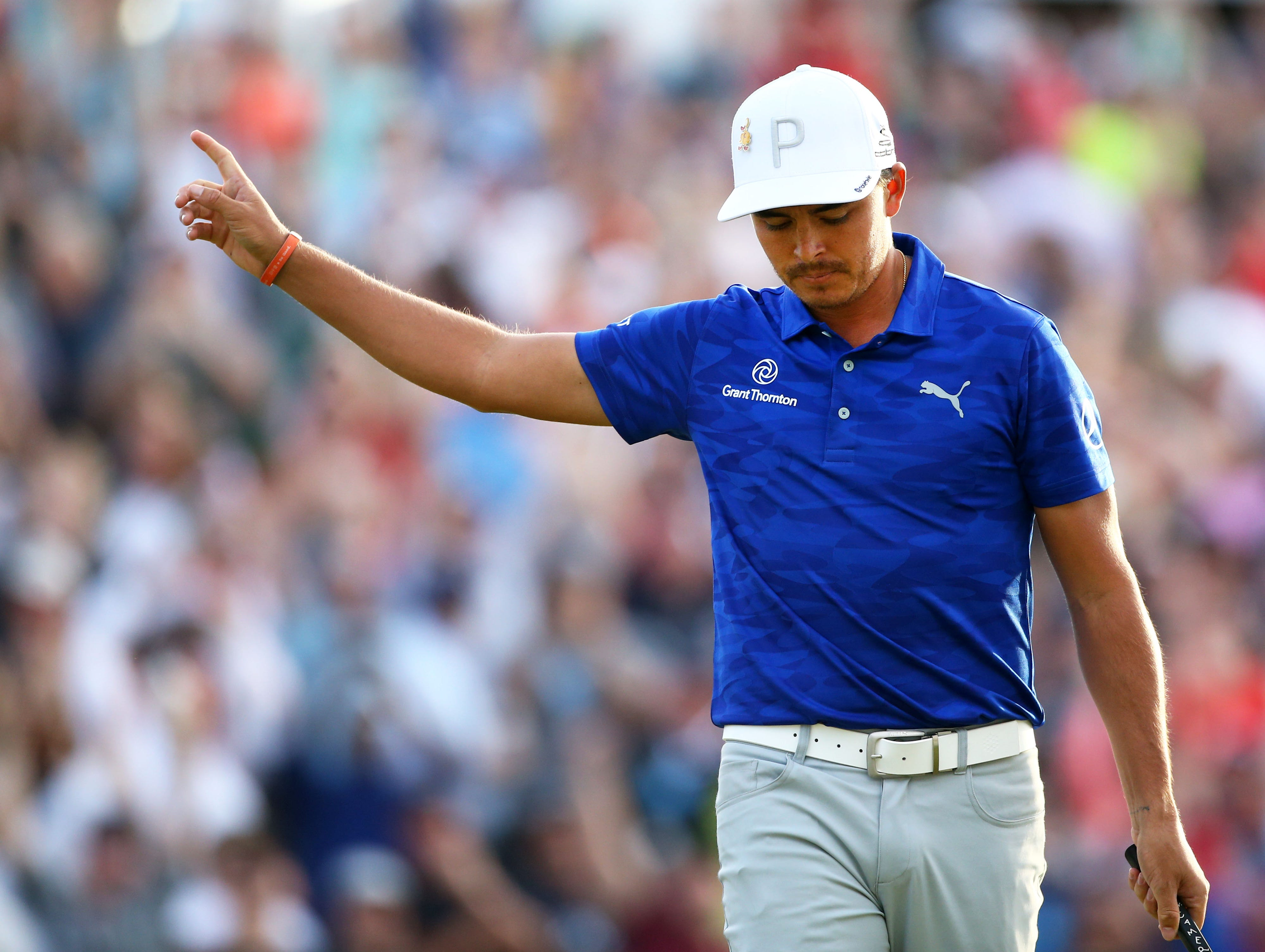 Rickie Fowler reacts after making a birdie on the 16th hole during second round action on Feb. 1 during the Waste Management Phoenix Open at the TPC Scottsdale Stadium Course.