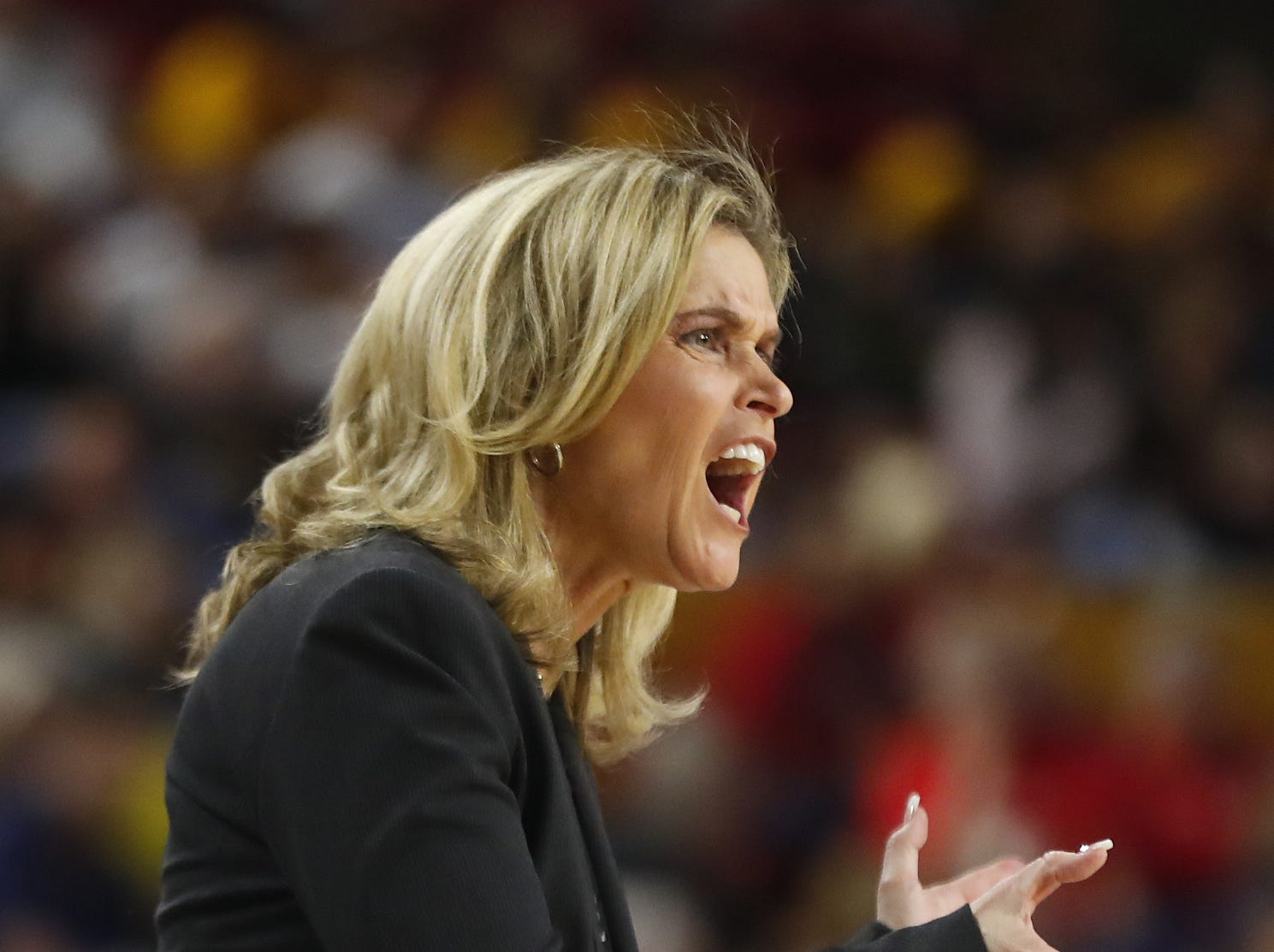 ASU's head coach Charli Turner Thorne claps after her team secures an offensive rebound against Arizona during the second half at Wells Fargo Arena in Tempe, Ariz. on February 1, 2019.