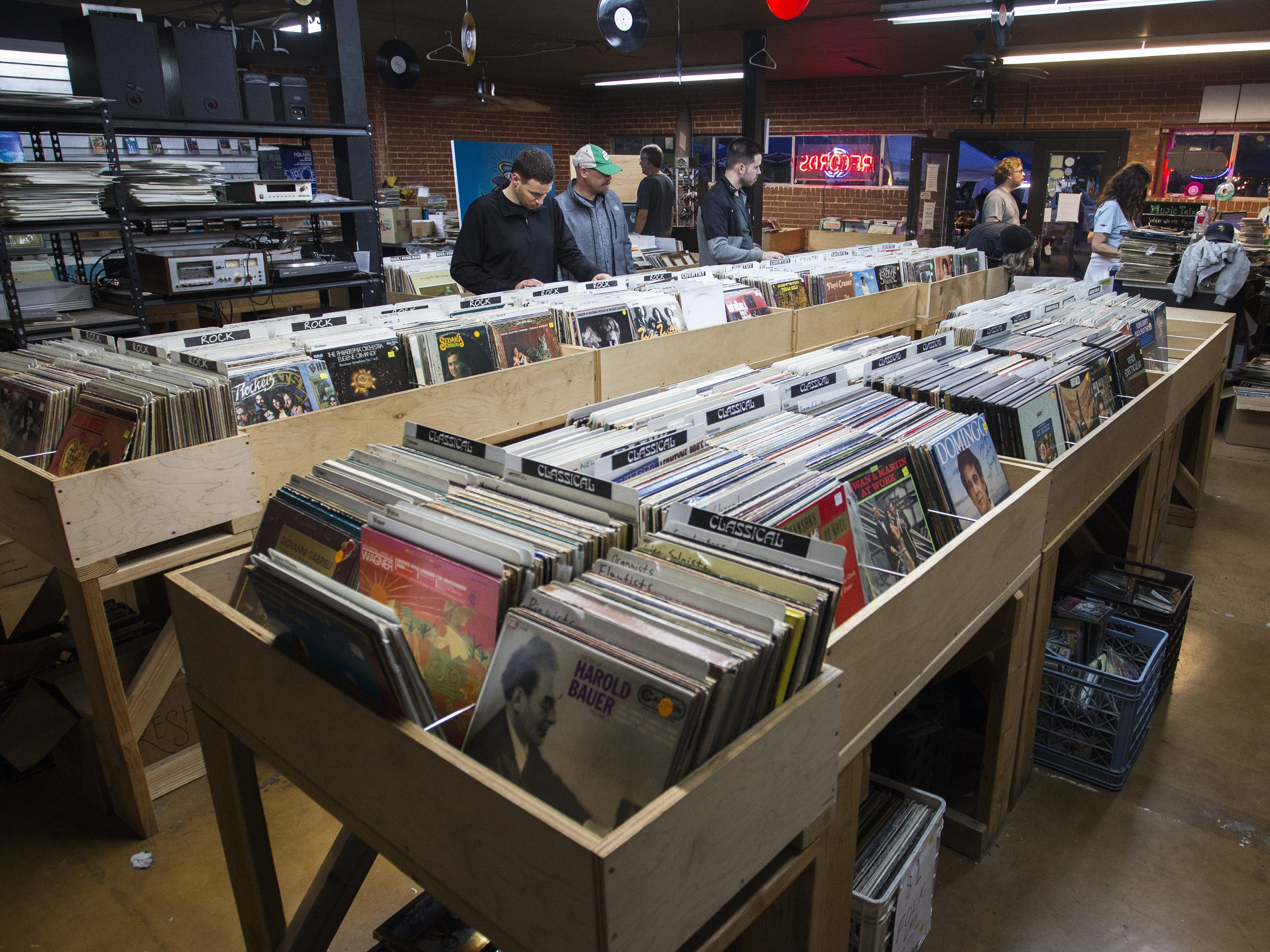 Music lovers sort through albums at Revolver Records in downtown Phoenix on First Friday.