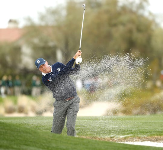 Matt Kuchar hits from the fairway bunker on the 2nd hole during the third round of the Waste Management Phoenix Open at TPC Scottsdale in Scottsdale, Ariz. on February 2, 2019.