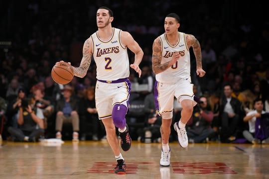 Lakers point guard Lonzo Ball runs the floor during a game against the Cavaliers at Staples Center.