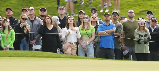 Fans try to see if a putt will drop on the second hole during the third round of the Waste Management Phoenix Open at TPC Scottsdale in Scottsdale, Ariz. on February 2, 2019.