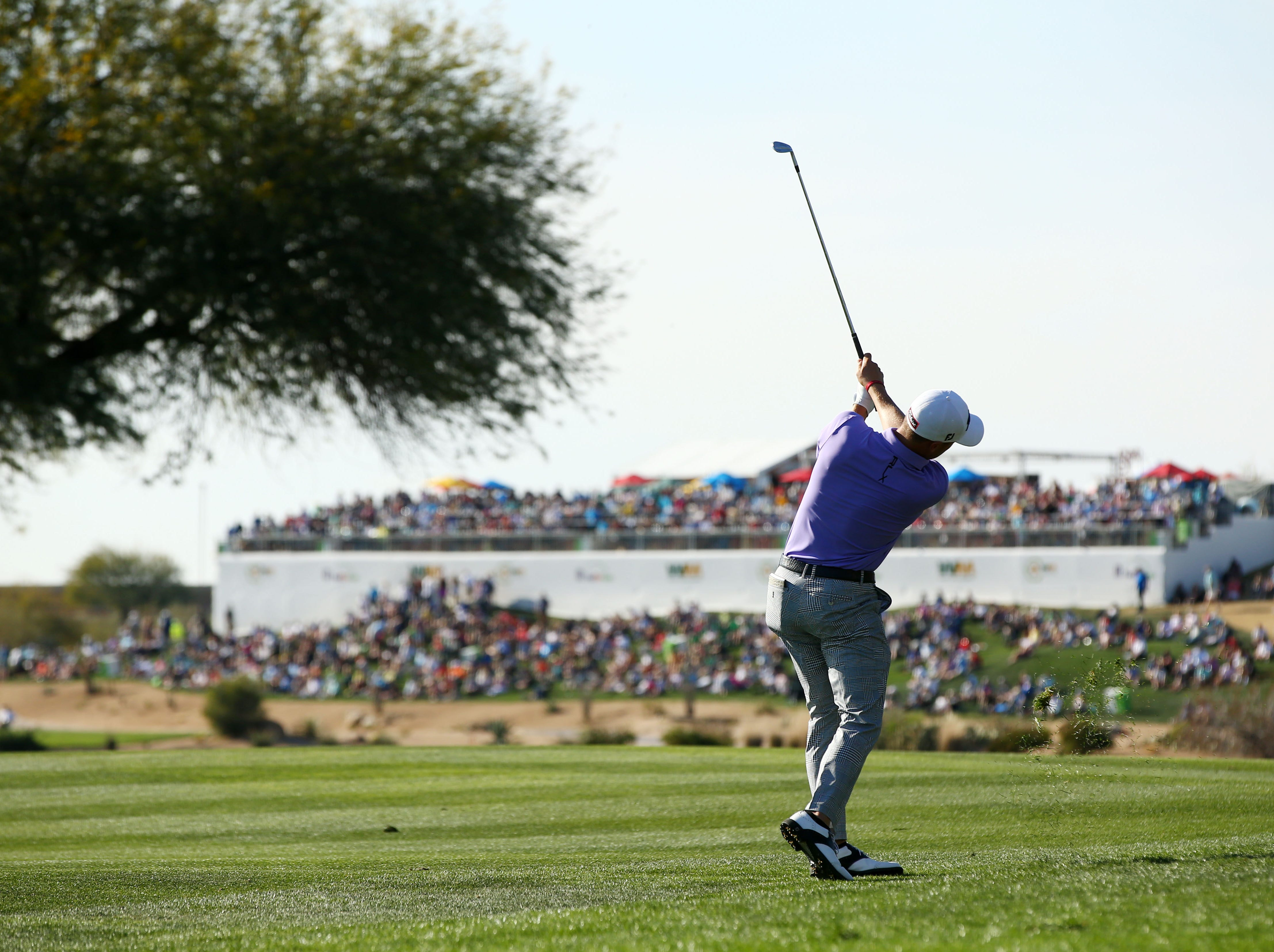 Justin Thomas plays his second shot on the 11th hole during second round action on Feb. 1 during the Waste Management Phoenix Open at the TPC Scottsdale Stadium Course.