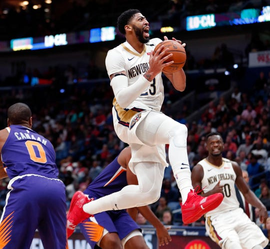 New Orleans Pelicans forward Anthony Davis (23) drives to the basket in the second half of an NBA basketball game against the Phoenix Suns in New Orleans, Saturday, Nov. 10, 2018. The Pelicans won 119-99. (AP Photo/Gerald Herbert)