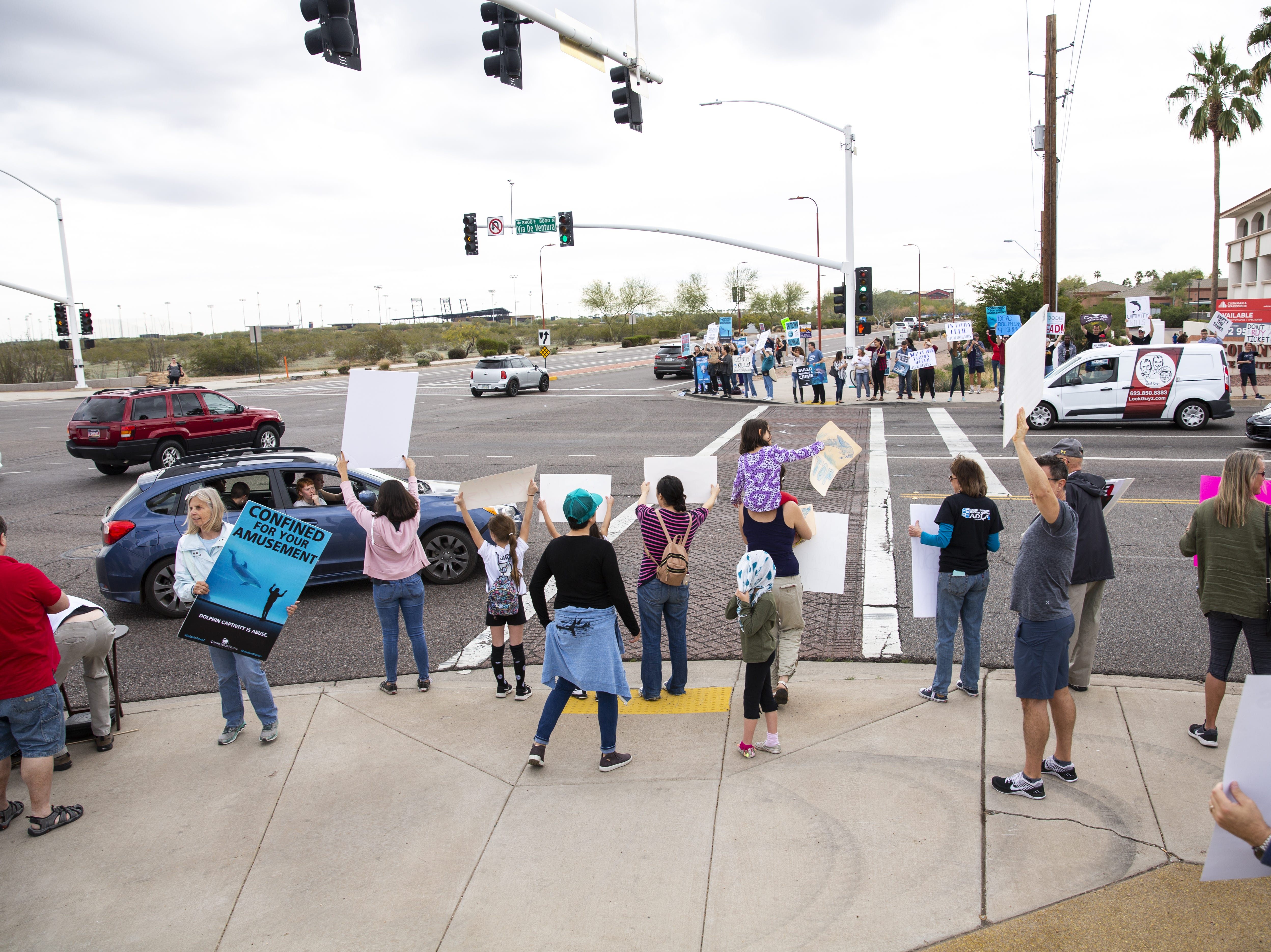 About 240 people had joined in the protest against Dolphinaris by 12 p.m. at the intersection of E. Via de Ventura and N. Pima Road in Scottsdale on Feb. 2, 2019.