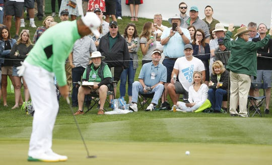 Gary Woodland putts on the 2nd green during the third round of the Waste Management Phoenix Open at TPC Scottsdale in Scottsdale, Ariz. on February 2, 2019.