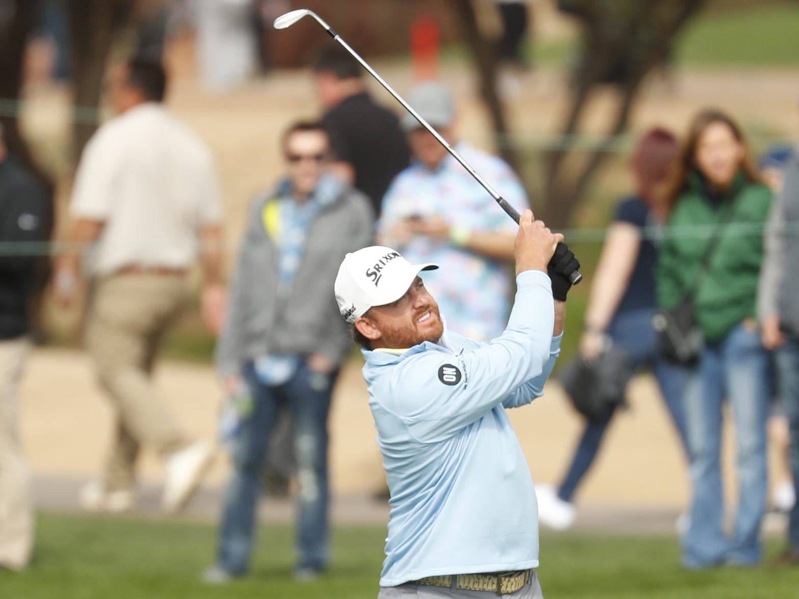 J.B. Holmes hits his third shot from the 9th fairway during the third round of the Waste Management Phoenix Open at TPC Scottsdale in Scottsdale, Ariz. on February 2, 2019.