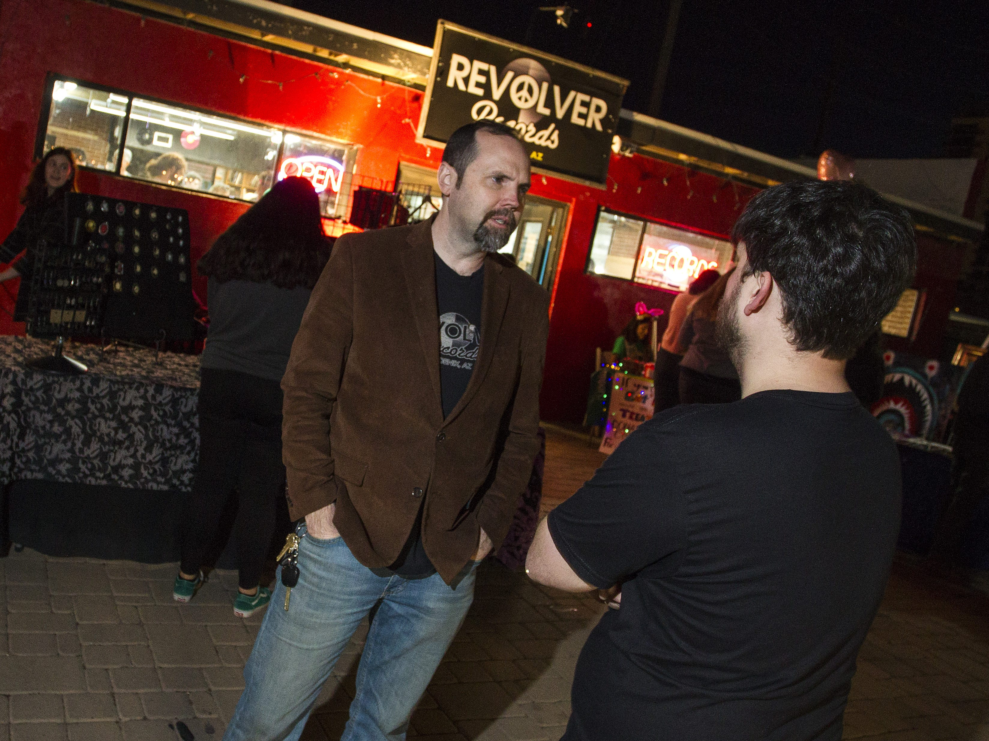Revolver Records' owner TJ Jordan talks with former employee Jared Cox outside of his record store in downtown Phoenix, Feb. 1, 2019.