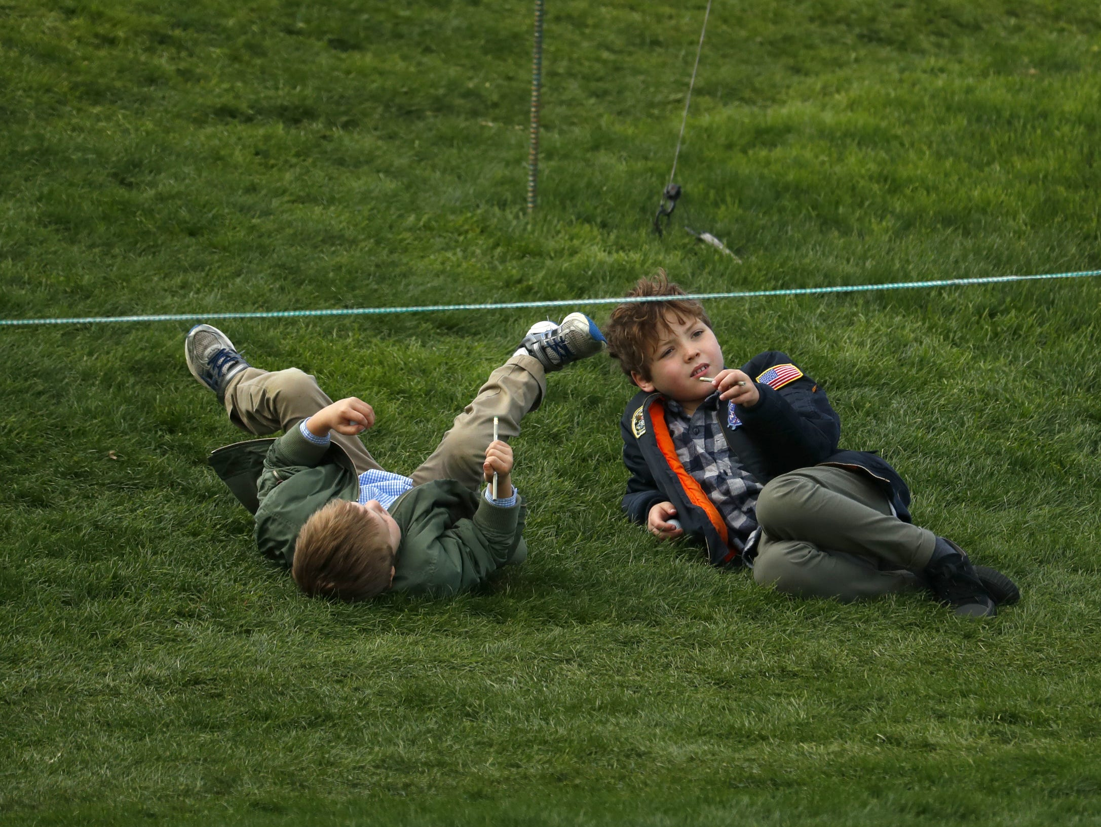 Children play near the 9th green during the third round of the Waste Management Phoenix Open at TPC Scottsdale in Scottsdale, Ariz. on February 2, 2019.