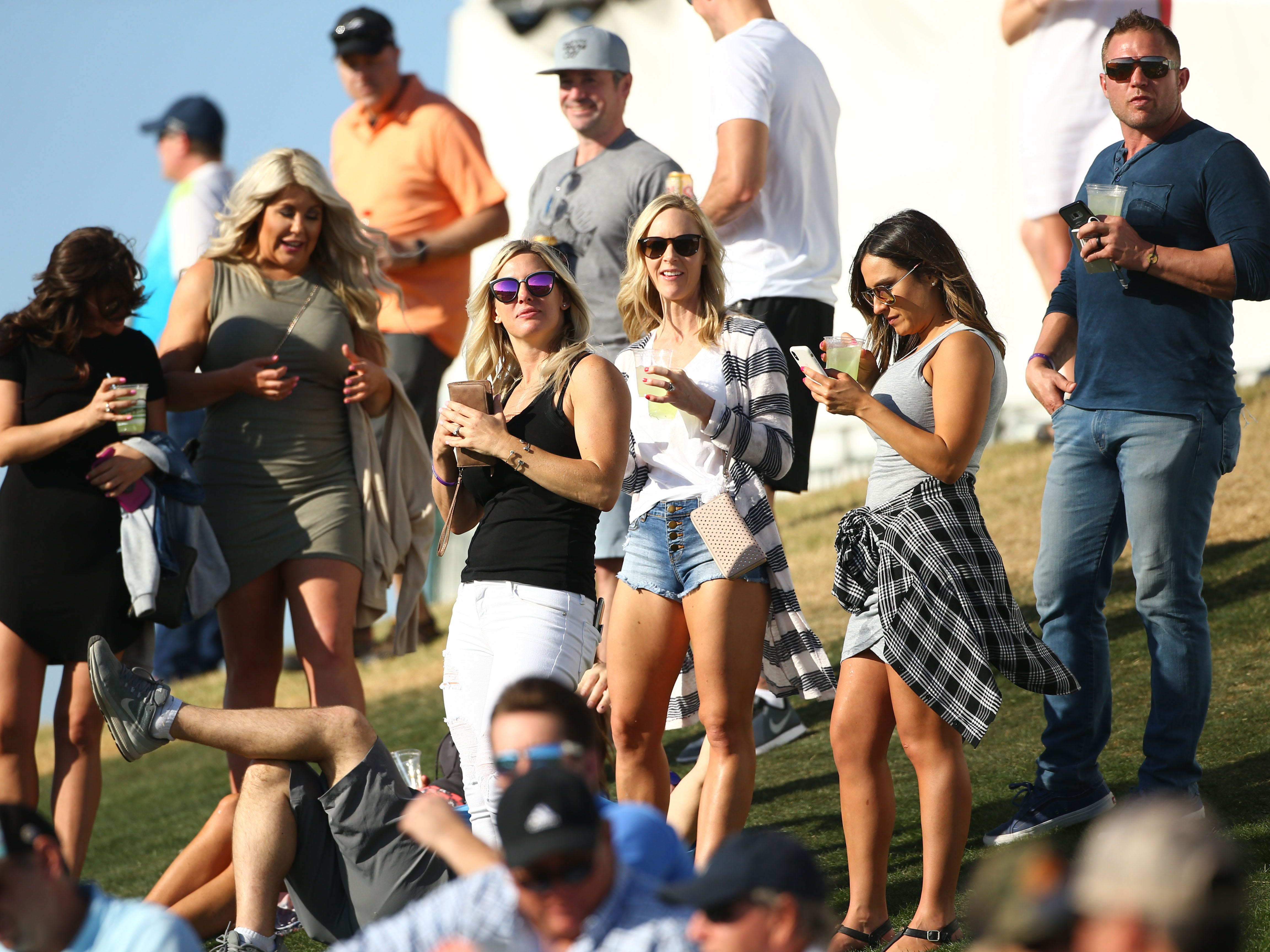Spectators watching on the 13th hole during second round action on Feb. 1 during the Waste Management Phoenix Open at the TPC Scottsdale Stadium Course.