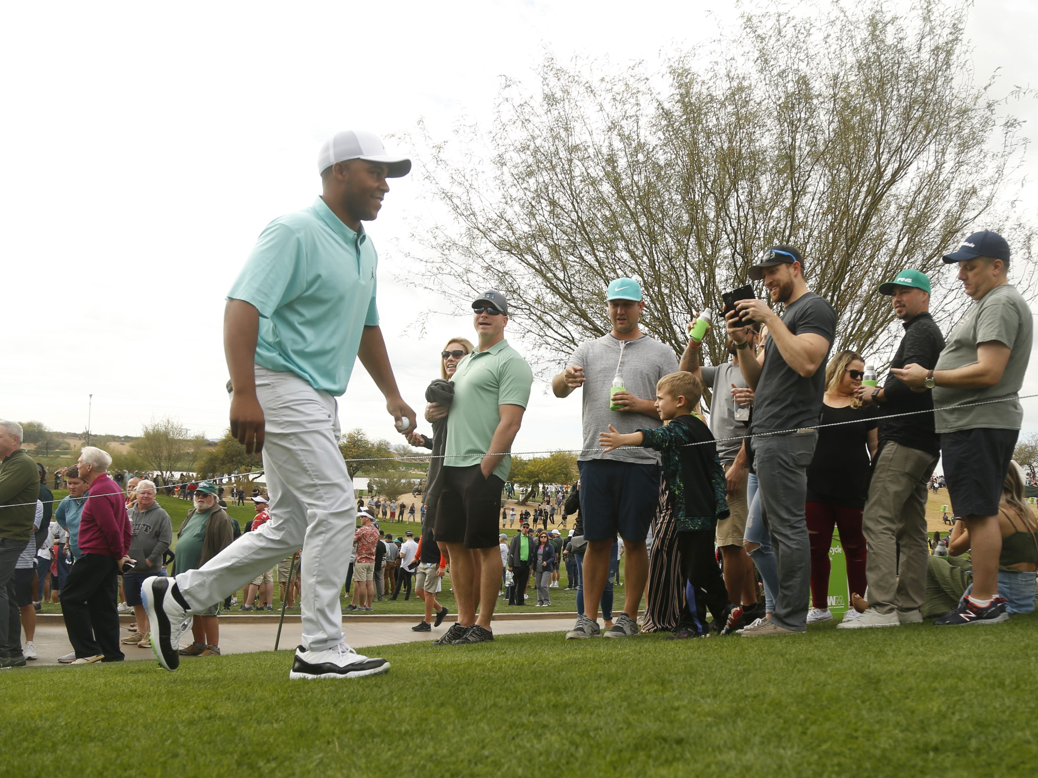 Harold Varner III walks up to the 8th tee box during the third round of the Waste Management Phoenix Open at TPC Scottsdale in Scottsdale, Ariz. on February 2, 2019.