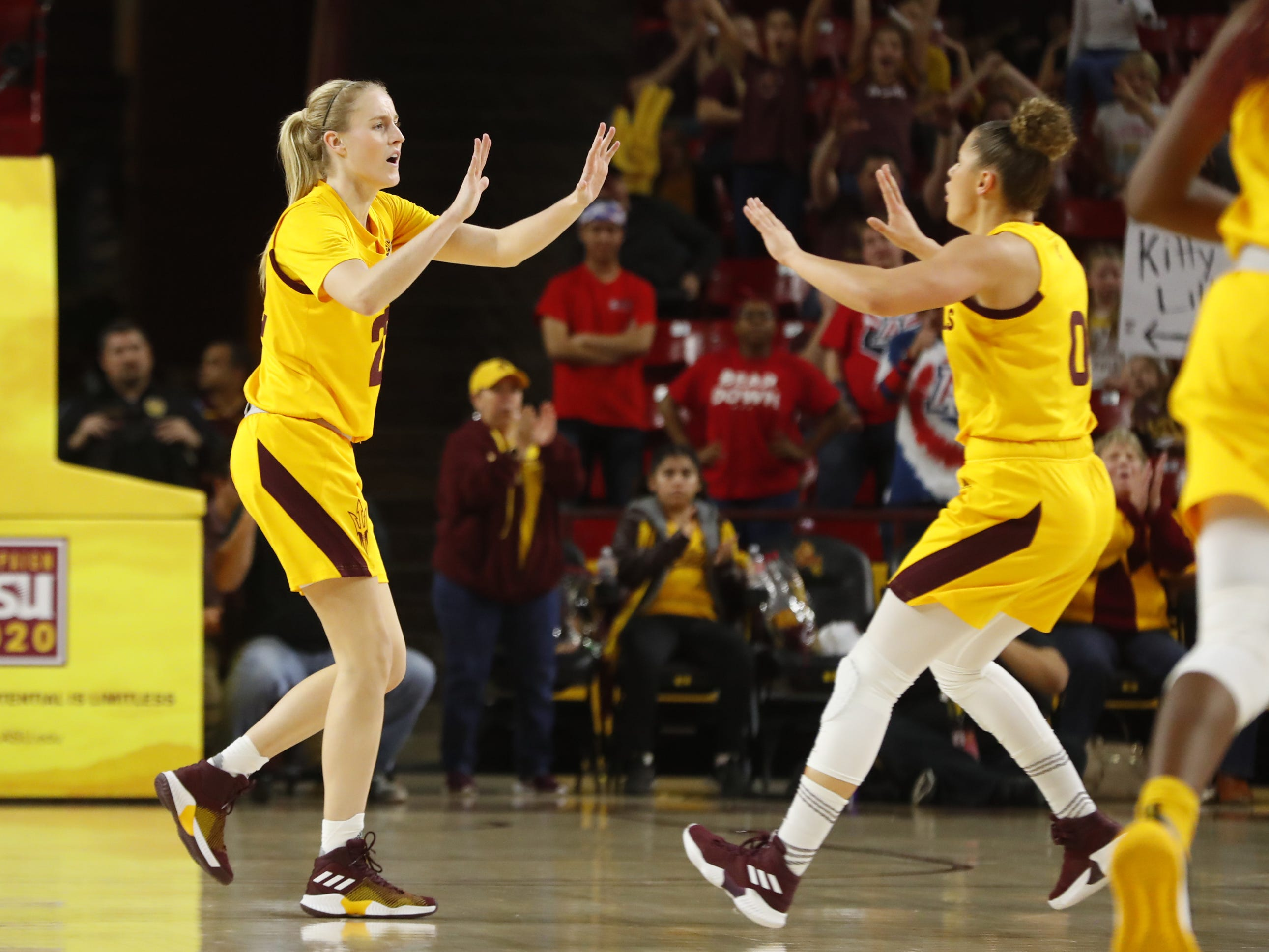 ASU's Courtney Ekmark (22) celebrates with Taya Hanson (0) after scoring against Arizona during the first half at Wells Fargo Arena in Tempe, Ariz. on February 1, 2019.