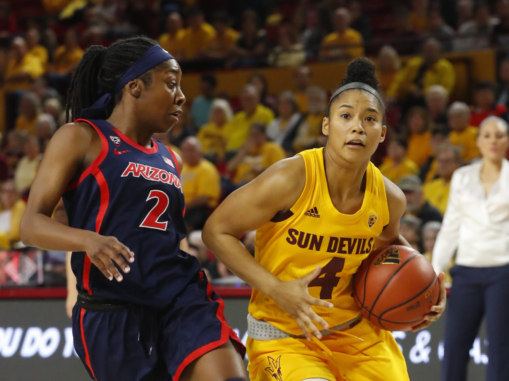 ASU's Kiara Russell (4) drives against Arizona's Aari McDonald (2) during the first half at Wells Fargo Arena in Tempe, Ariz. on February 1, 2019.